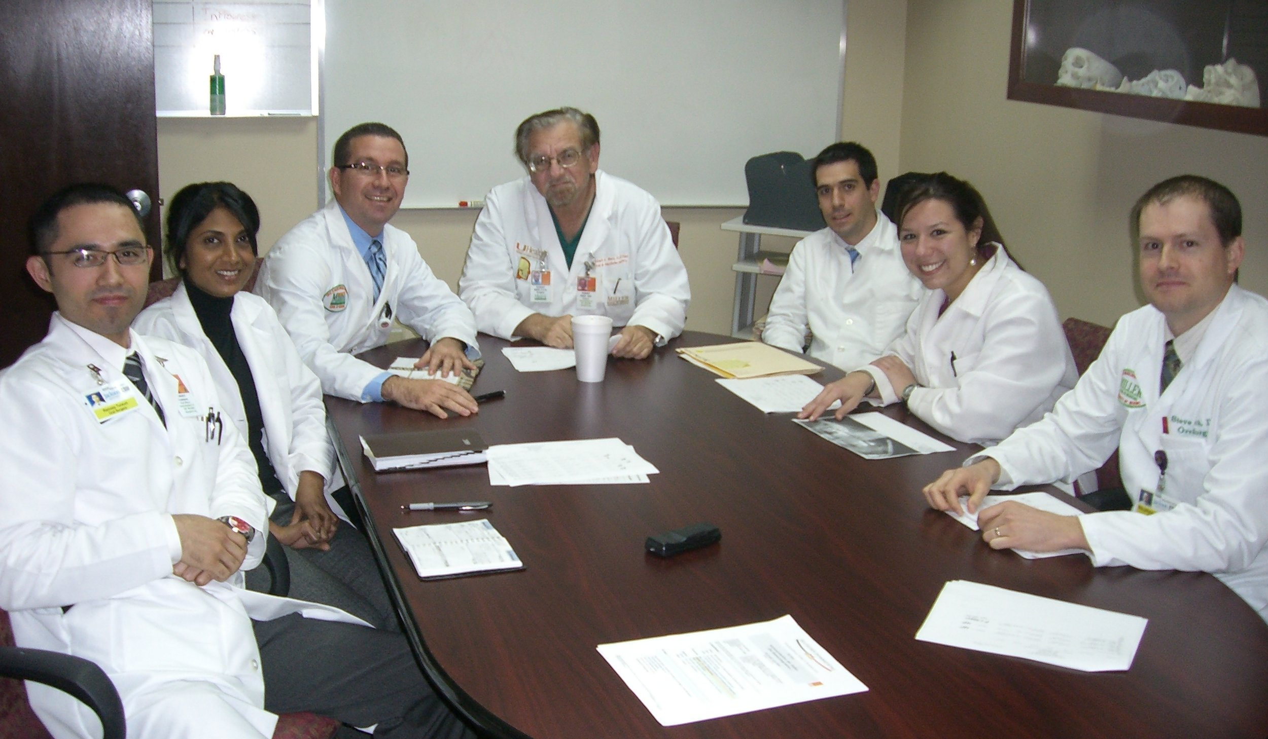 Dr. Johanny Caceres in a case discussion with Professor Robert Marx and other residents.