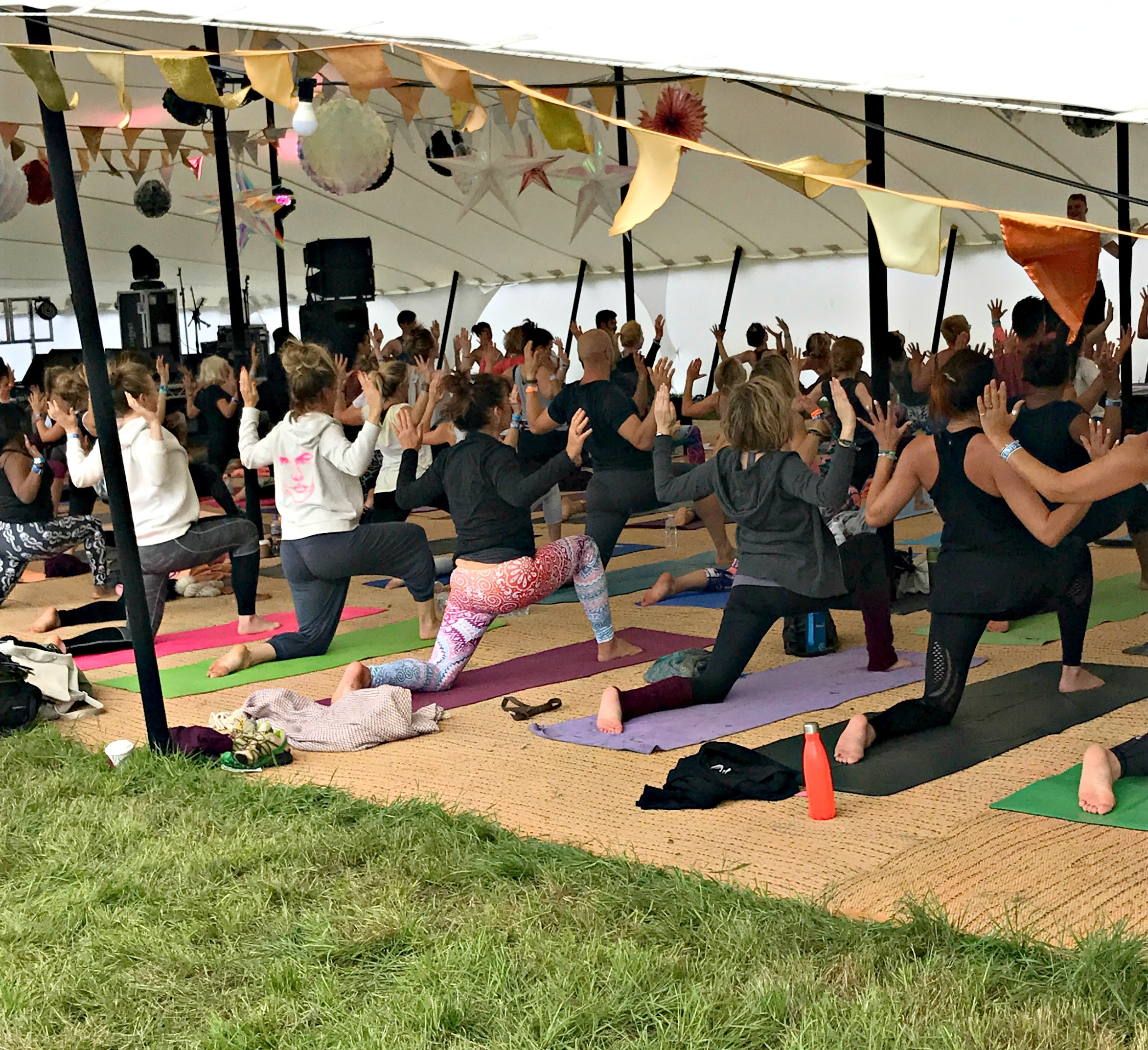 Do I want to join these crazy looking people doing yoga in a tent?! Yoga happening at  Soul Circus