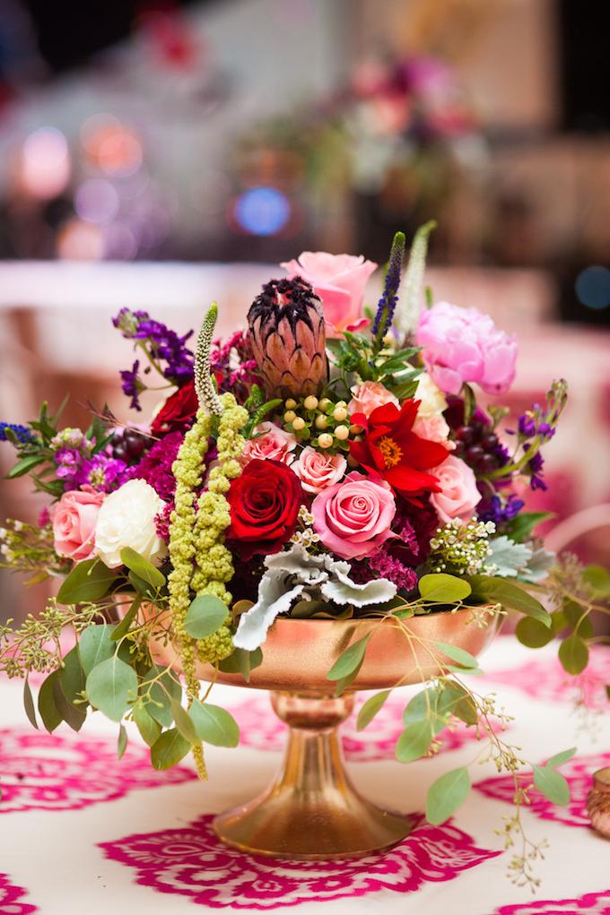 Rich floral centerpiece www.avenueievents.com.jpg