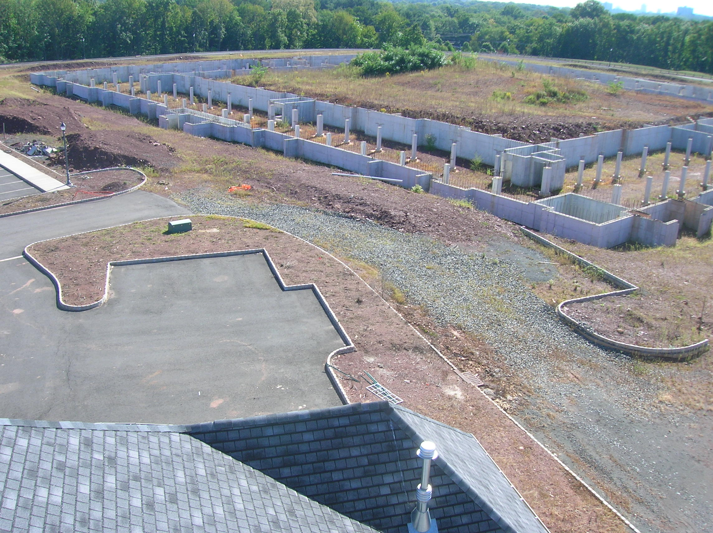 A picture from the roof of the single building built on the site by 2009 - the large shell of a community center