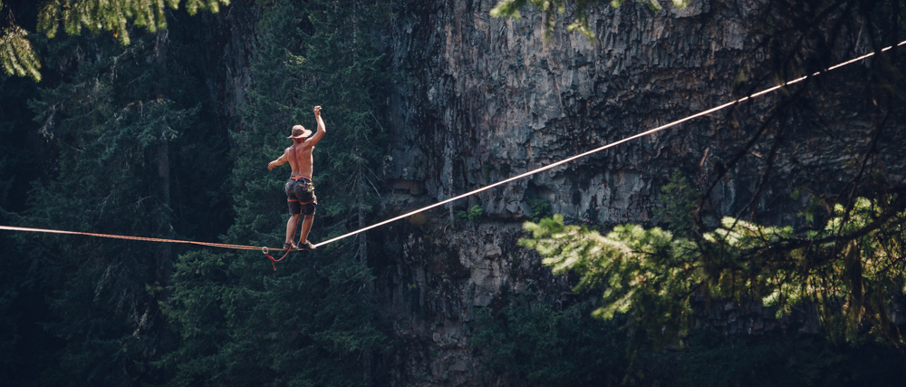 Spencer Seabrooke walking a highline at Brandywine Falls