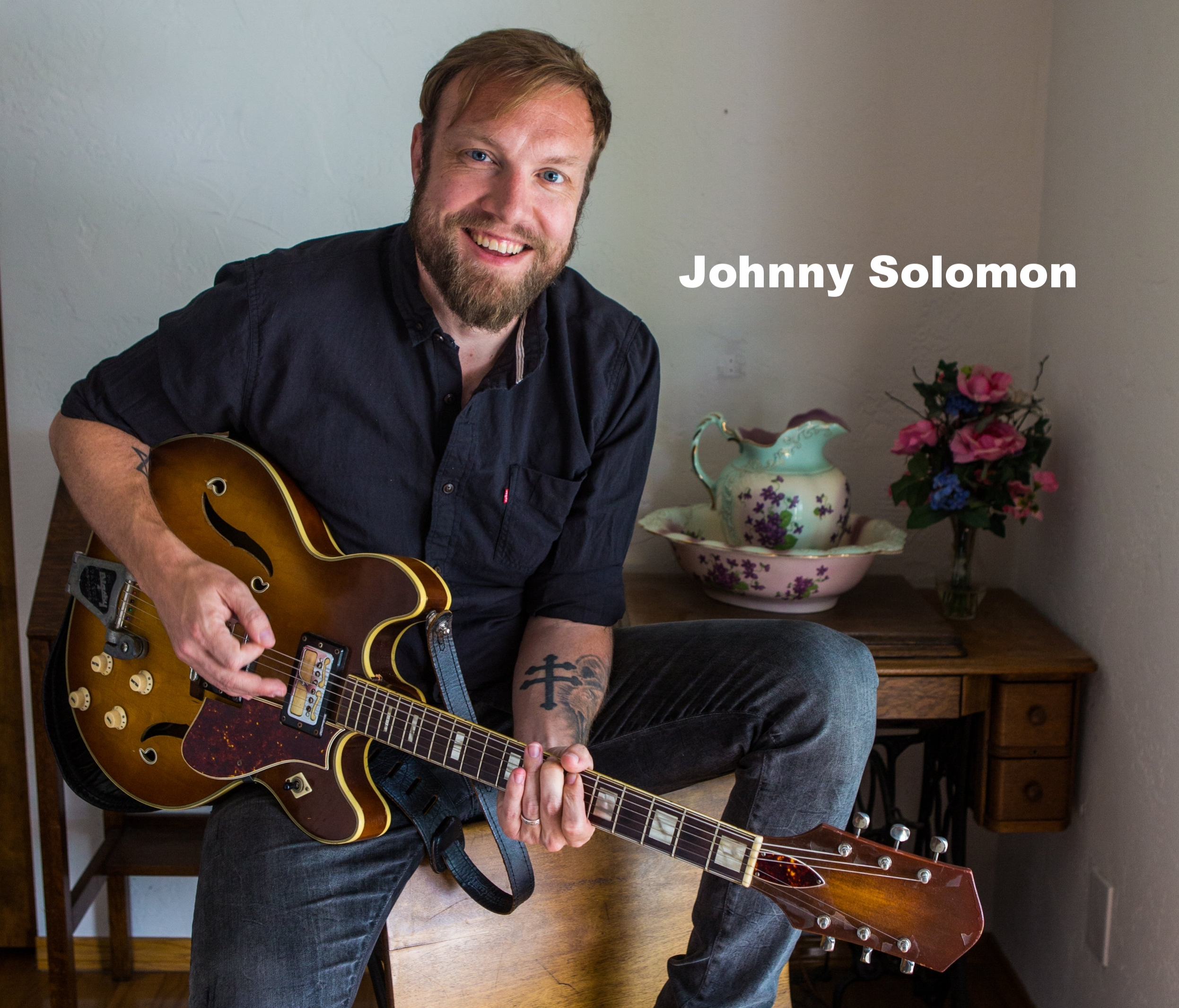 JOHNNY WITH GUITAR_HIGH-RES.jpg
