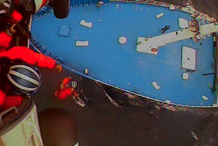 A helicopter crew from Coast Guard Air Station Kodiak rescues a man from the F/V Golden Alaska on Feb. 20.  Credit Courtesy of U.S. Coast Guard
