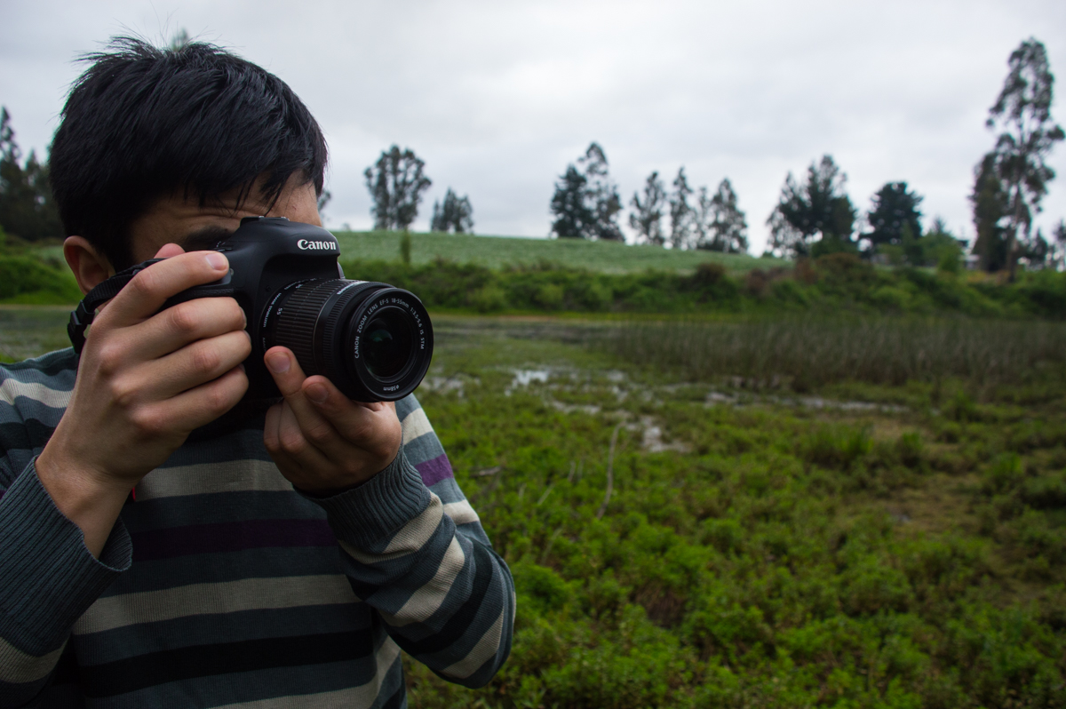 Felipe always takes photos of events in the community. He frequently looks back through them to remember his best times.