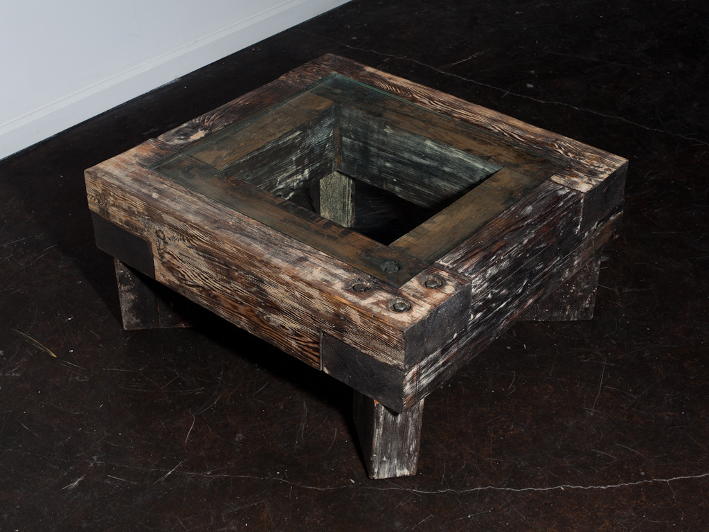 Coffee table of reclaimed materials by  Adam Lam .