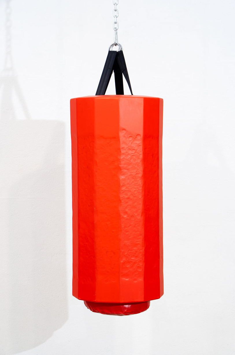 PACKS A PUNCH, 2007   Acrylic paint on plywood, fixings, boxing bag   250 x 45 x 45 cm