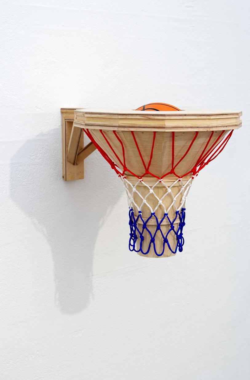 BASKET CASE, 2007   Plywood, pine, hoop net, basketball   48 x 63 x 50 cm