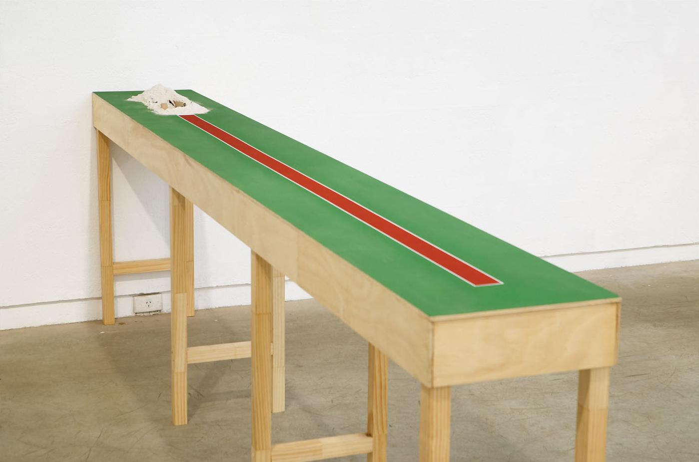 DIGGING IN (2004) Enamel on Plywood, Steel, Casting Sand 2 x 38 x 310 cm