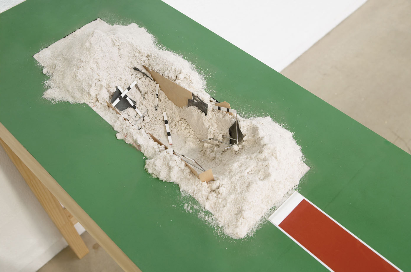 DIGGING IN (2004) Enamel on Plywood, Steel, Casting Sand 92 x 38 x 310 cm