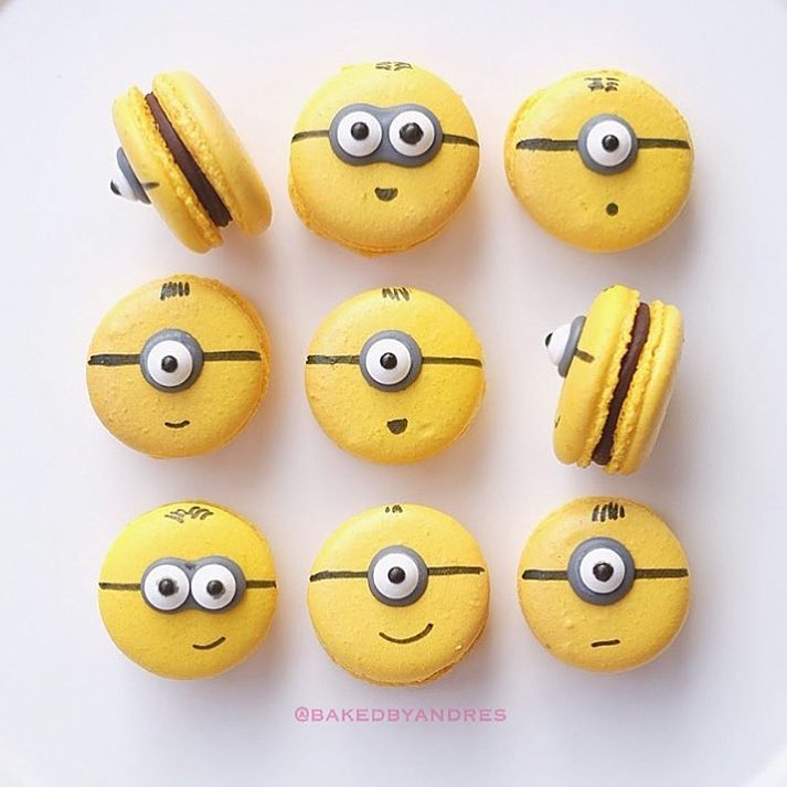 Minions macarons   Banana macarons with chocolate ganache. Aren't they cute?