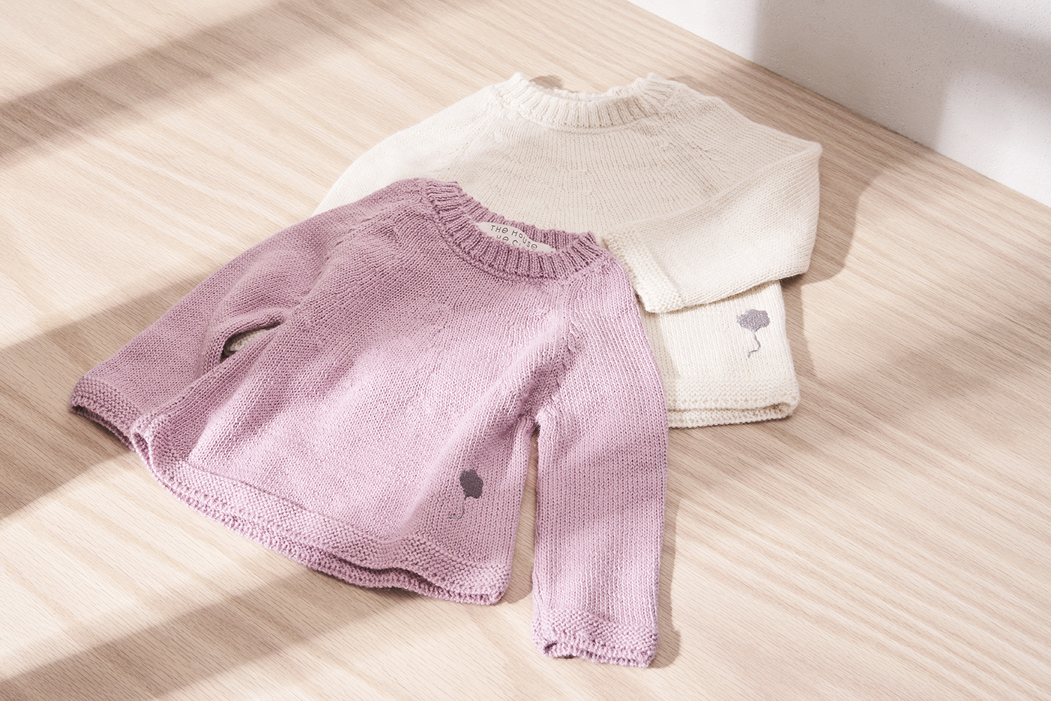 Neel Sweaters in Cumulus White and Pink Cotton.jpg