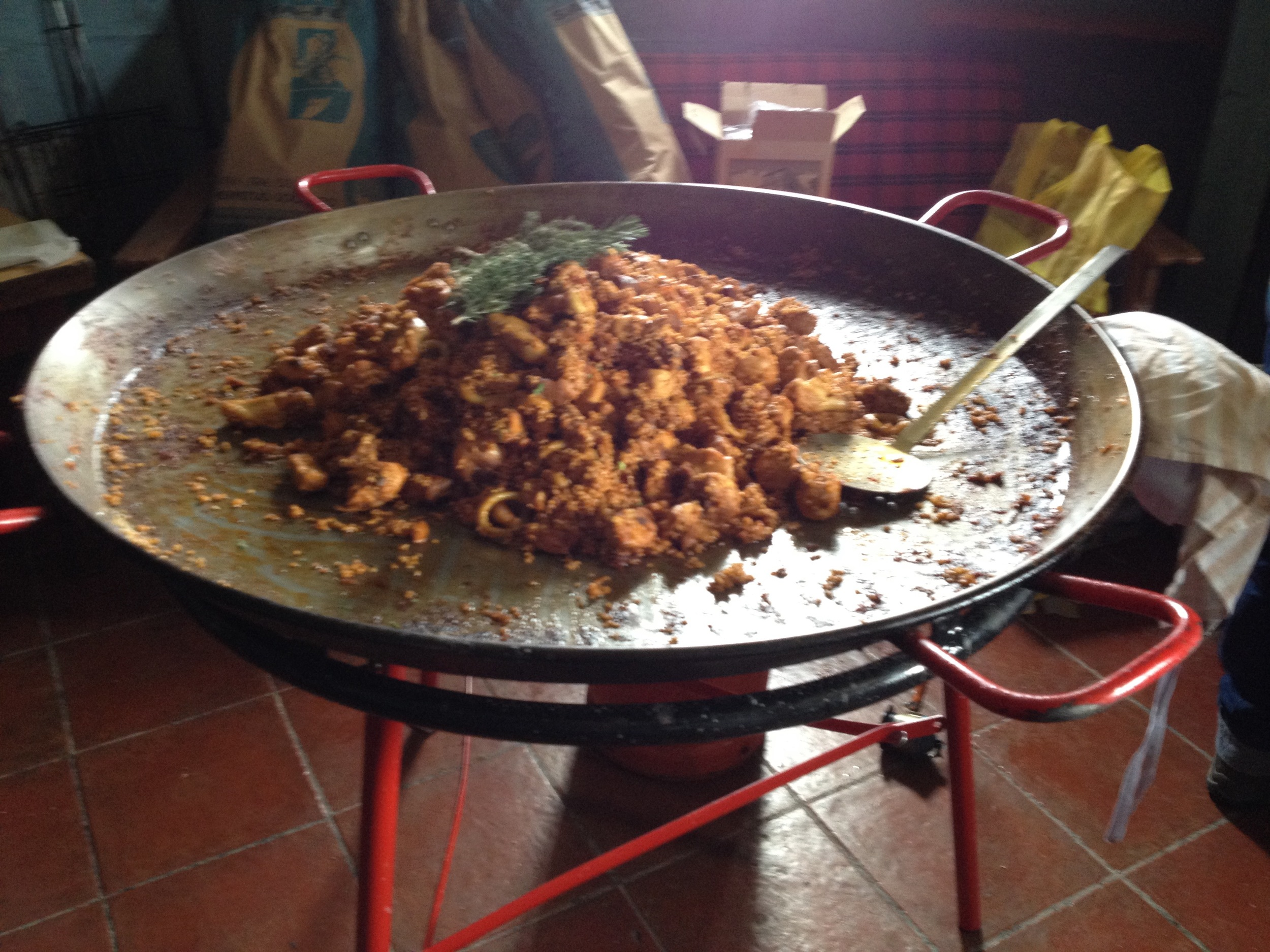 A giant dish of  paella  - what Spaniards call a  paellaca  (a BIG paella) - cooked in a hiker's hut atop the Sierra Nevada mountains.