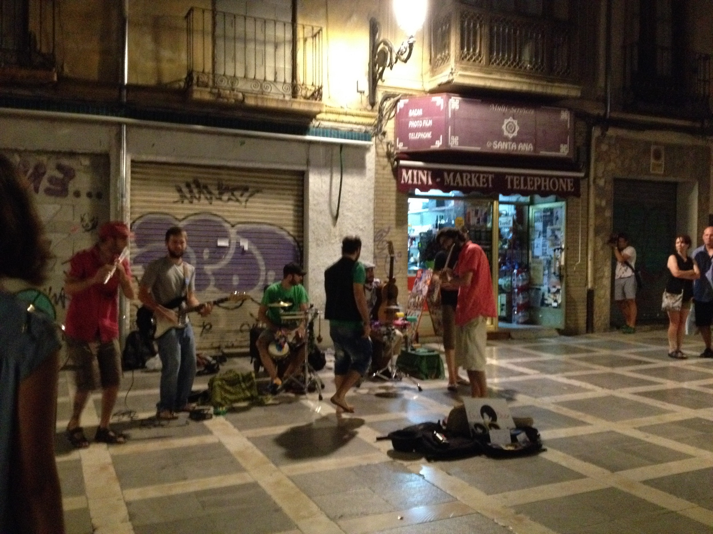 Street musicians jamming in Plaza Nueva, a fairly normal sight during Granada's warmer months.