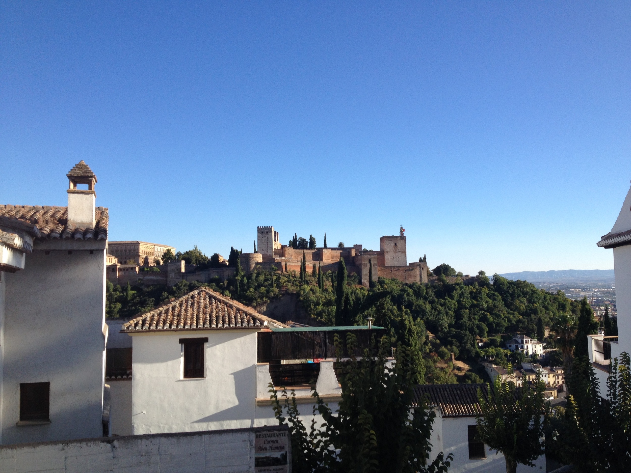 View of the Alhambra on a cloudless day from the Albaicín.