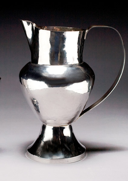 Rosalie Roos Wiener (American, d. 1982, active Newcomb College 1931-1935), Pitcher, c. 1930-35, Hand-hammered sterling silver, H. to top of rim: 11 in. Diam foot: 5 3/16 in. Max. diam (belly): 6 3/8. Max. width (spout to handle): 9 in., Purchased with funds from the Friends of LSU Museum of Art Endowment with assistance from the Jean Bragg Gallery, LSUMOA 2008.3.1
