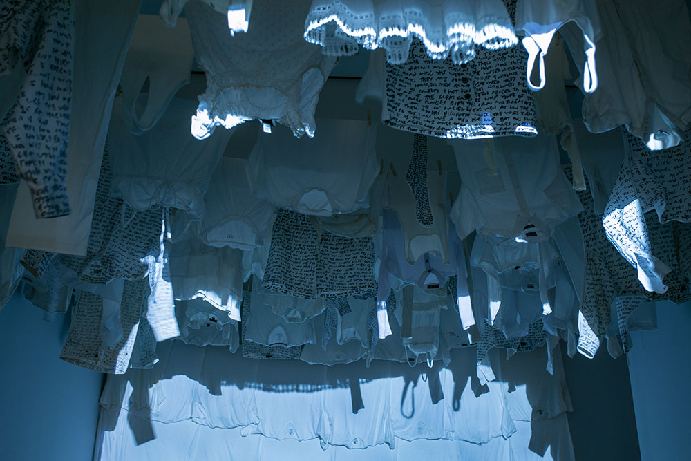 Malcolm McClay's   Swimming to Inishkeel   installation with video projection and clothes