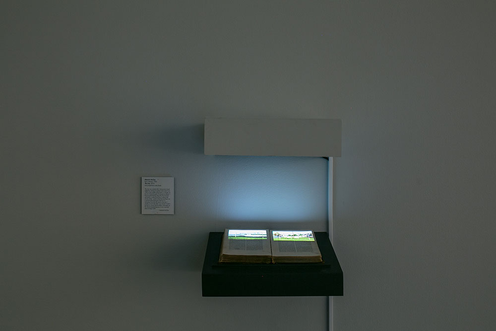 Malcolm McClay's   The Line   video projection onto book