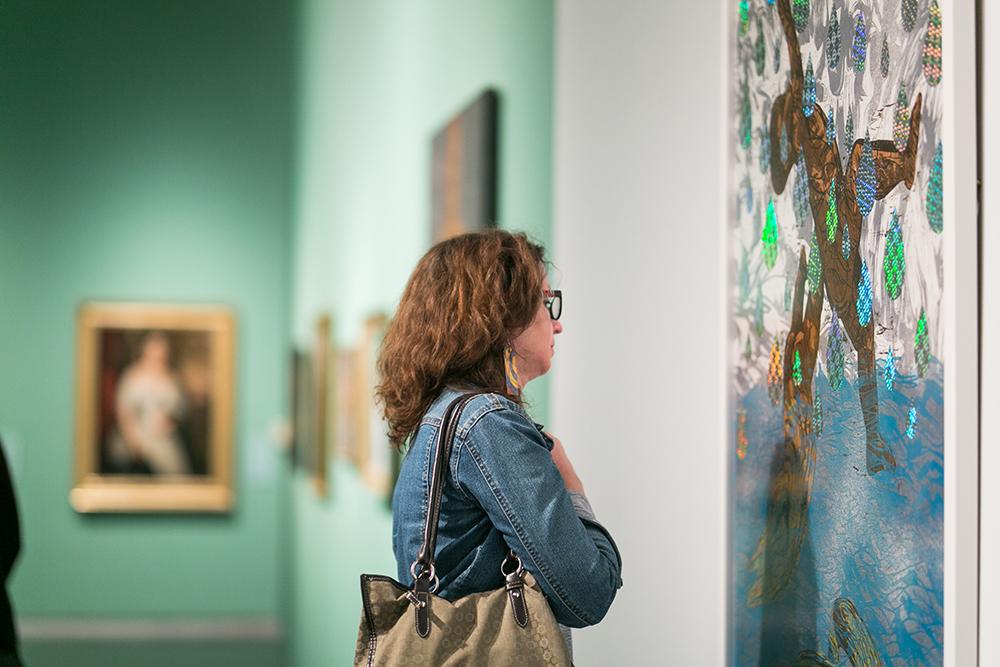 Woman looking at Katrina Andry print