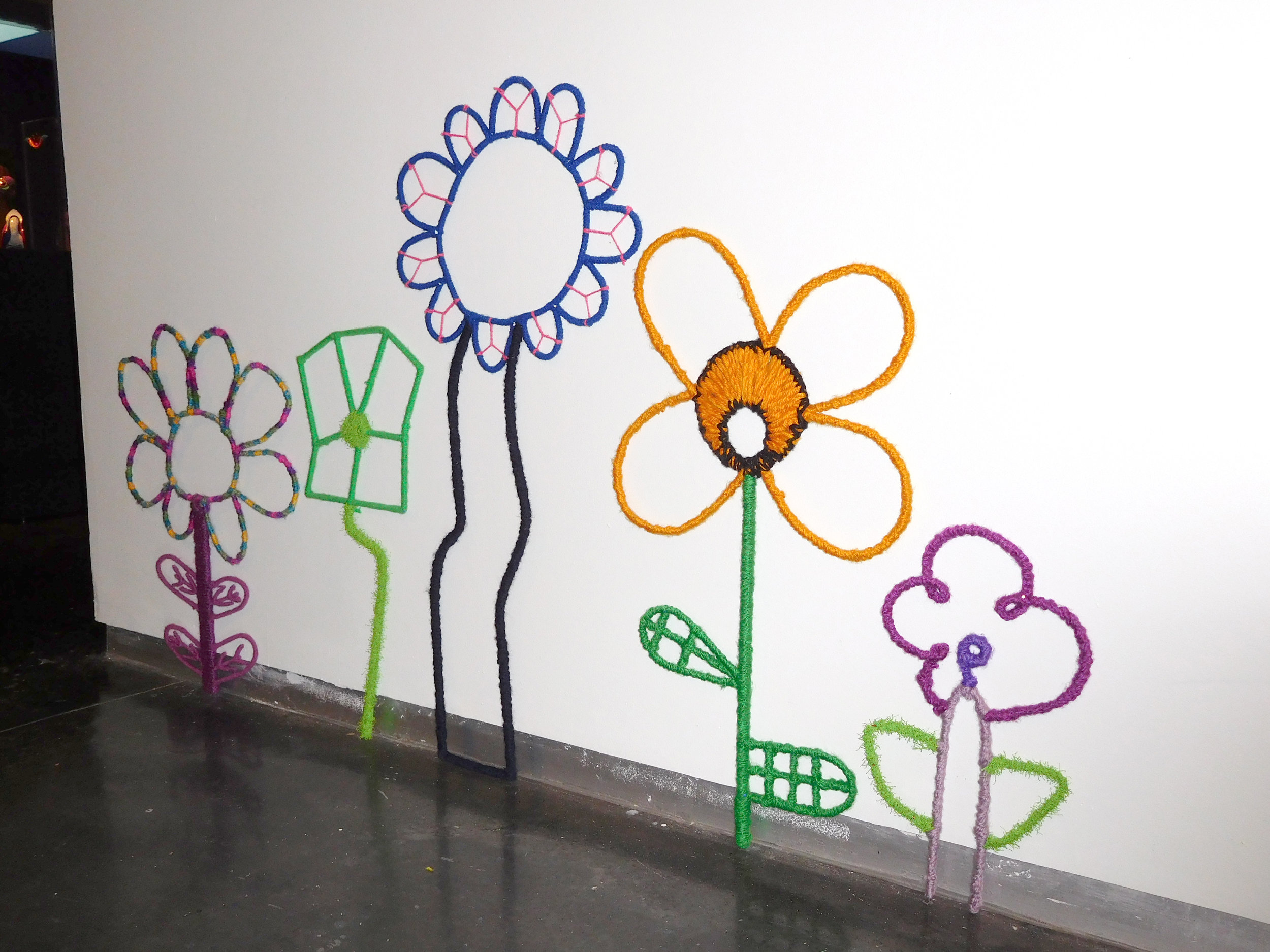 Large wired flowers made from kids' drawings
