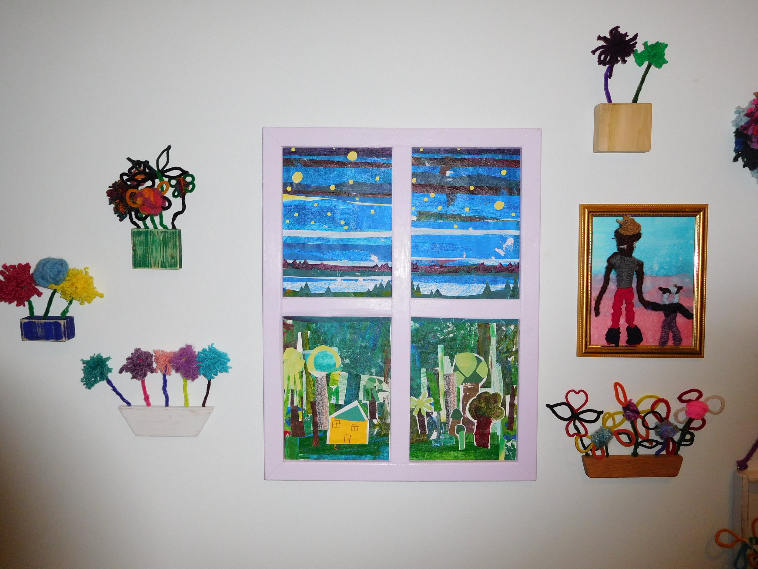 Collaged windows and other NAP summer artworks on display in Gather and Grow.