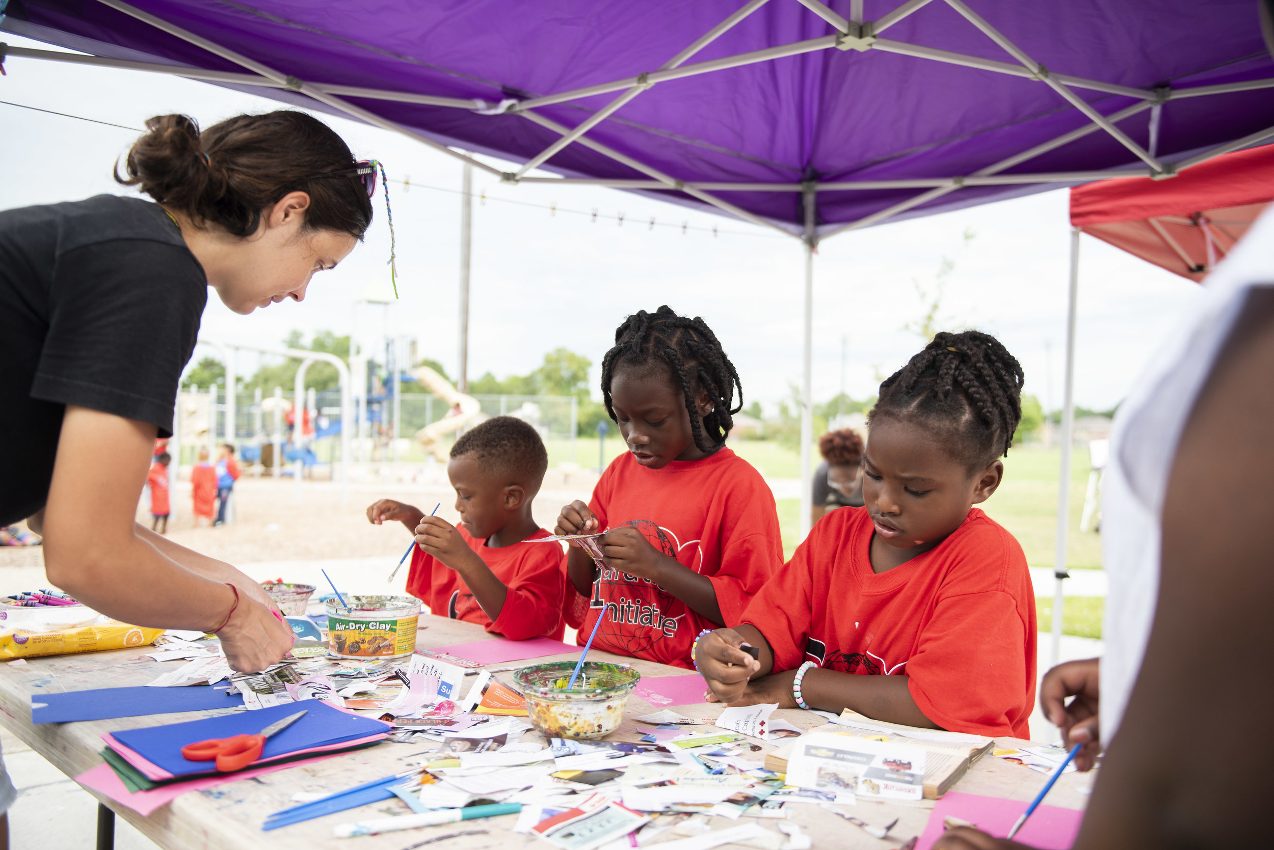 NAP assistant, Samantha Combs, helps kids with art activities.