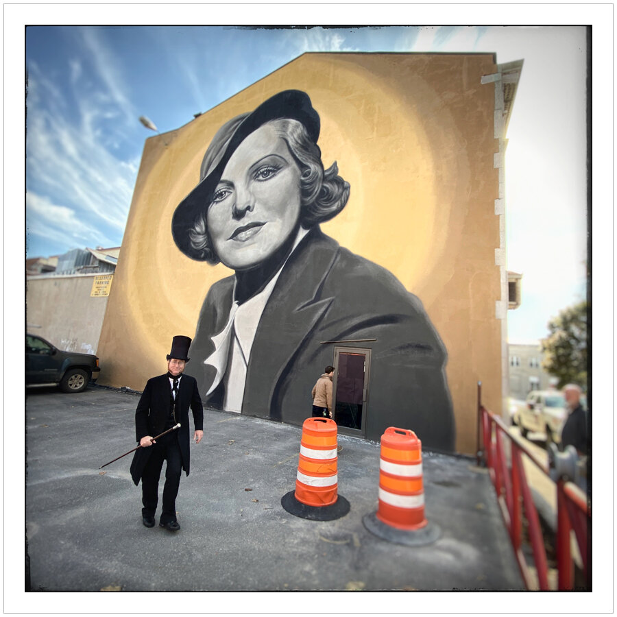 stovepipe hat guy with mural