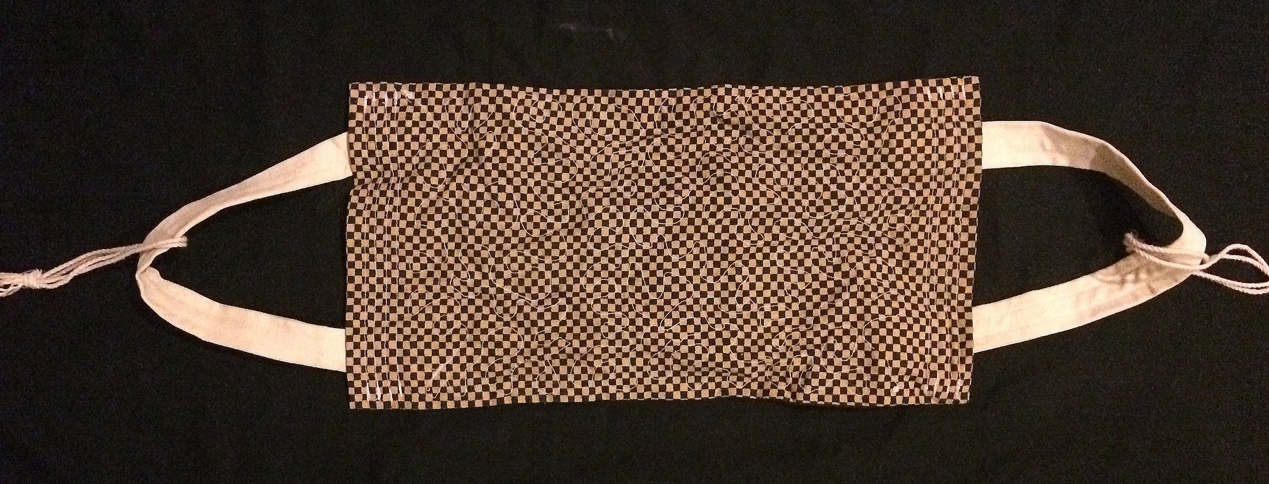 A backstrap sewn out of cloth.