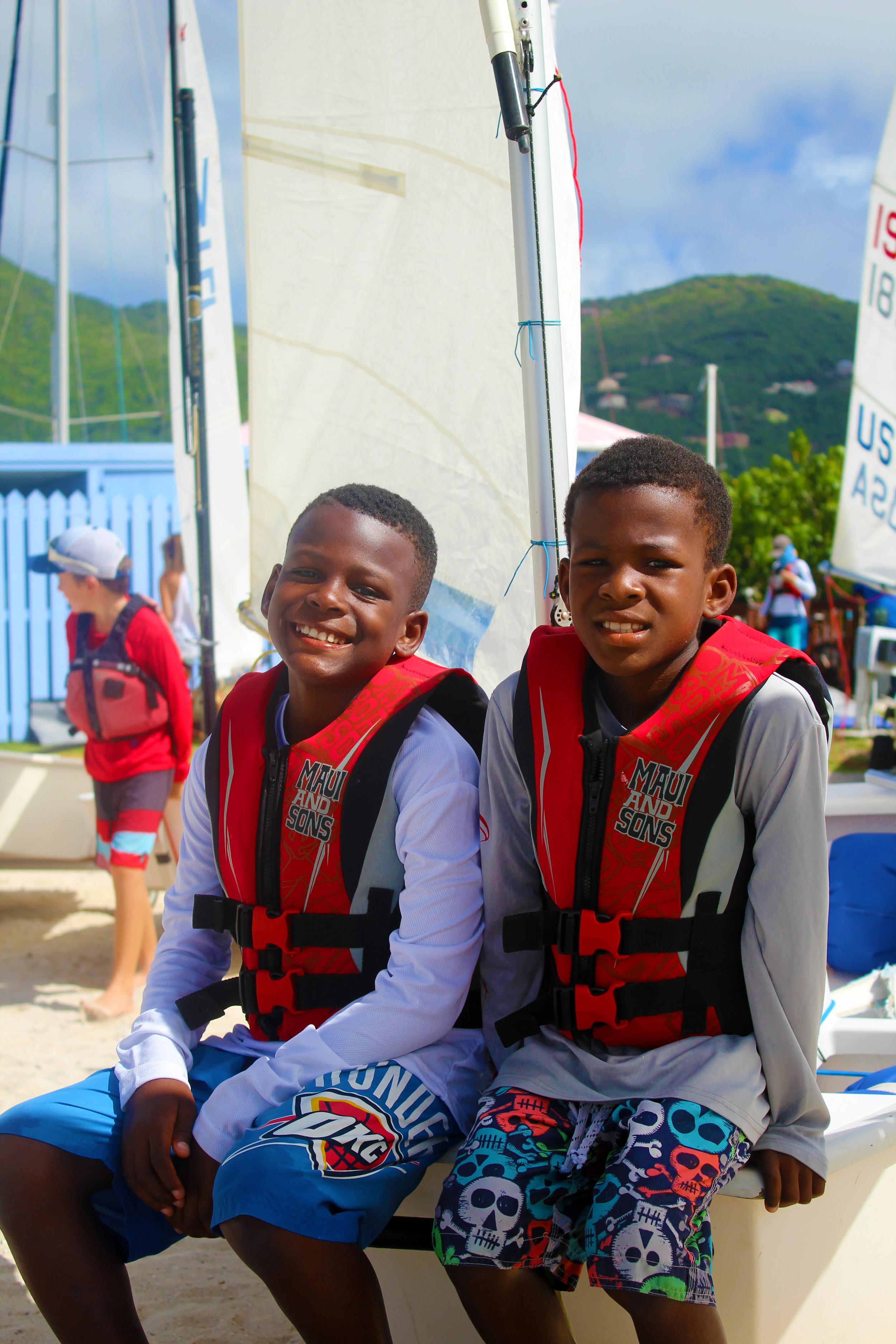 Rodney and Ryan Moorehead compete in Optimist Green fleet