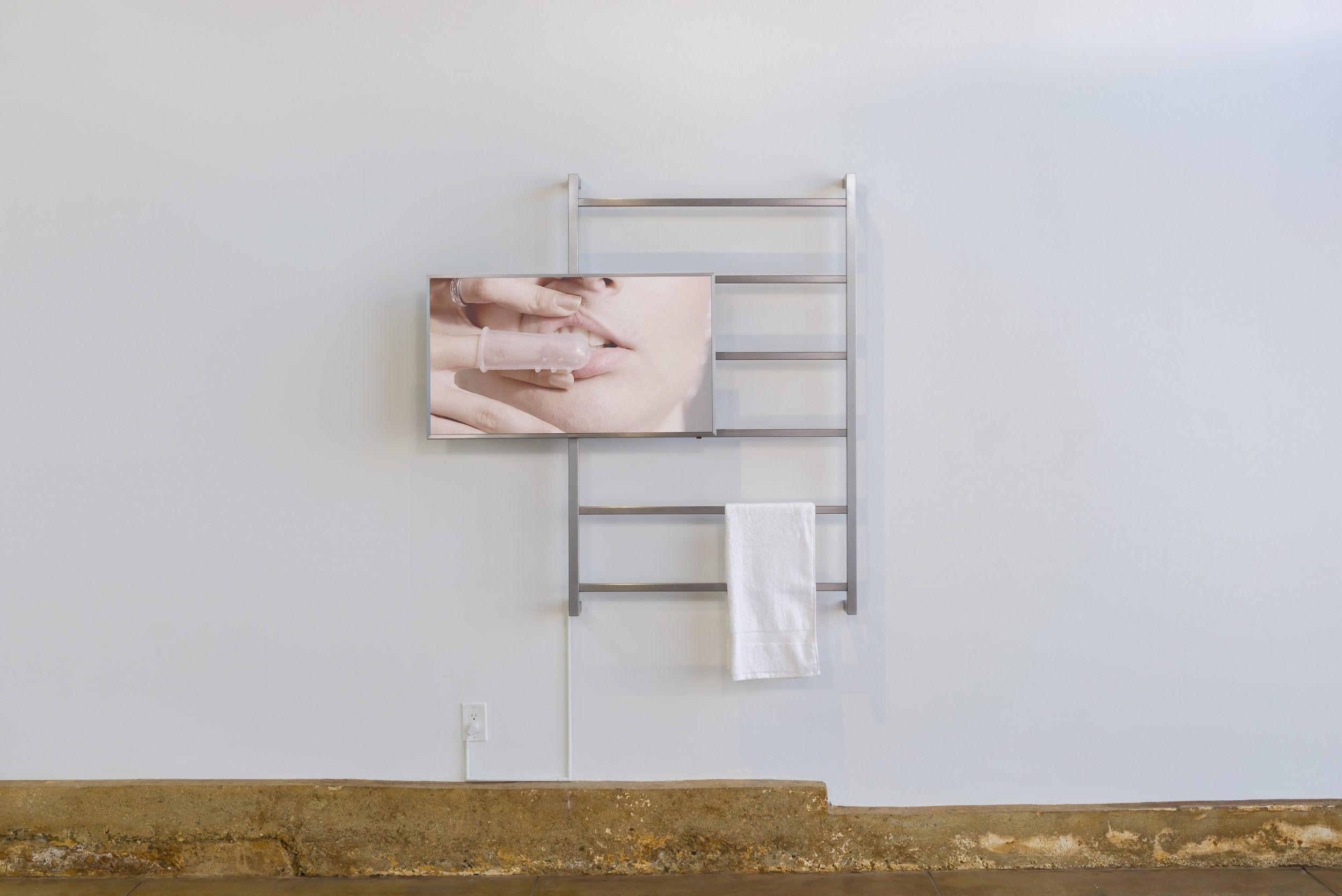 Amanda VIncelli  HYGIENA 2017 Single-channel HD video, brushed  steel, towel 6:11, loop, dimensions variable Ed. 5 + 2AP; Unique sculptural edition