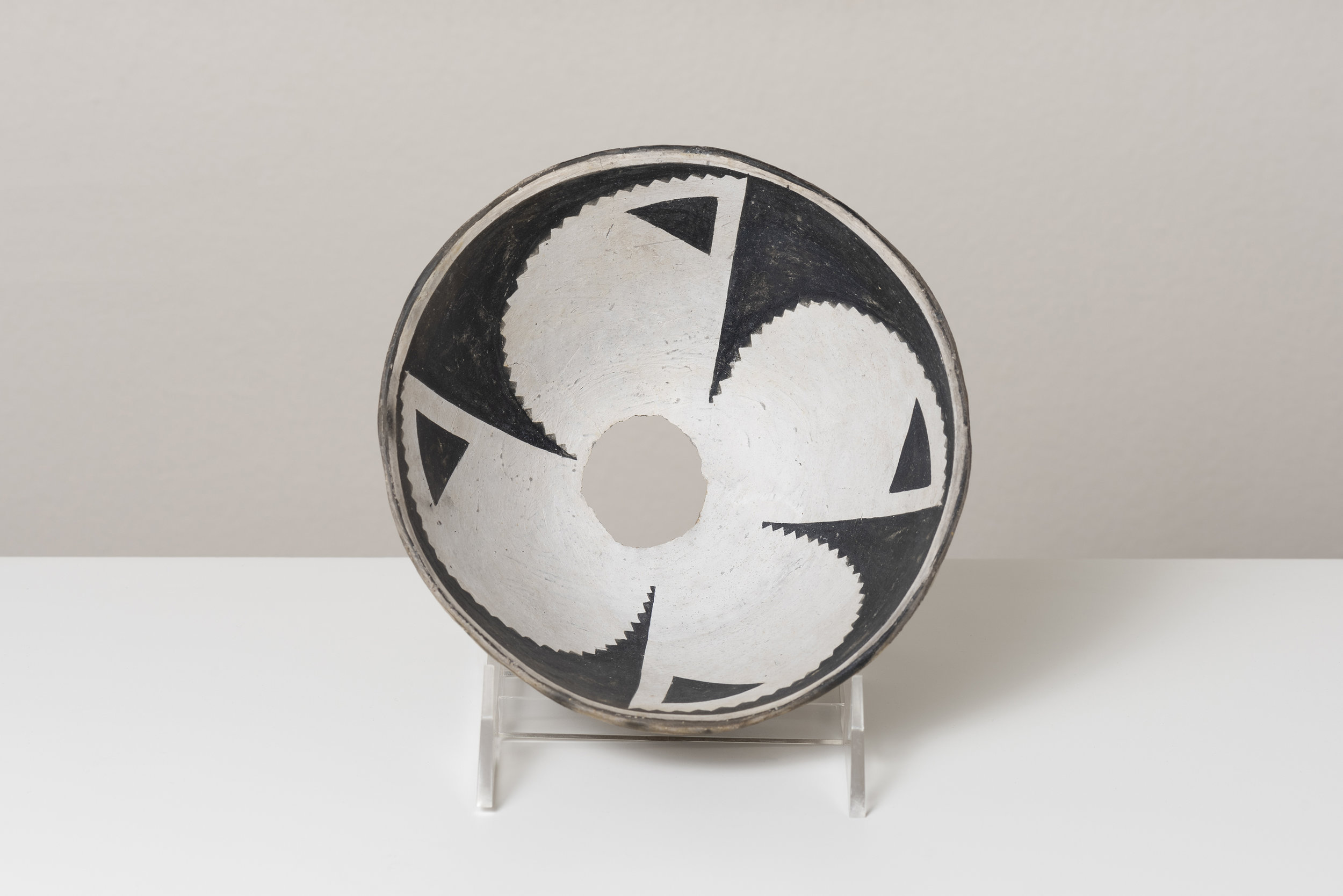 Classic Mimbres Black-on-white  Abstracted datura blossom c. 900 - 1000 CE Painted ceramic 6 inches diameter, 4 inches depth