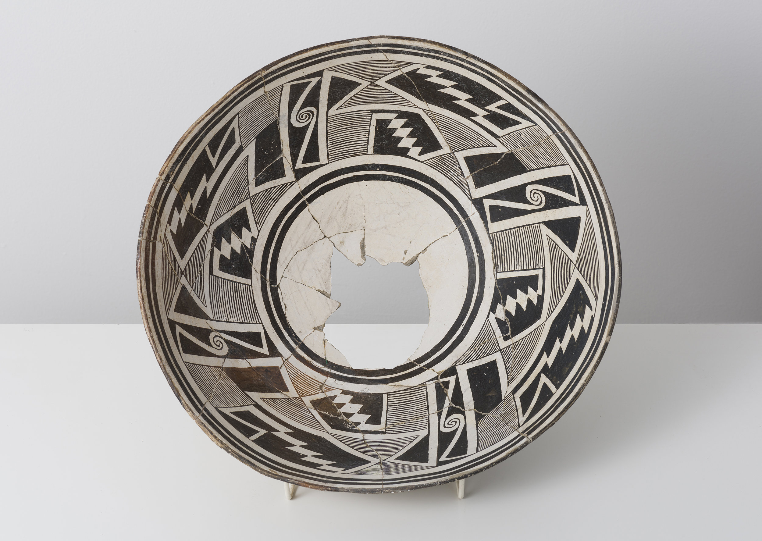 Classic Mimbres Black-on-white  Abstracted datura buds with entoptic patterns c. 900 - 1000 CE Painted ceramic 13 inches diameter, 4 inches depth