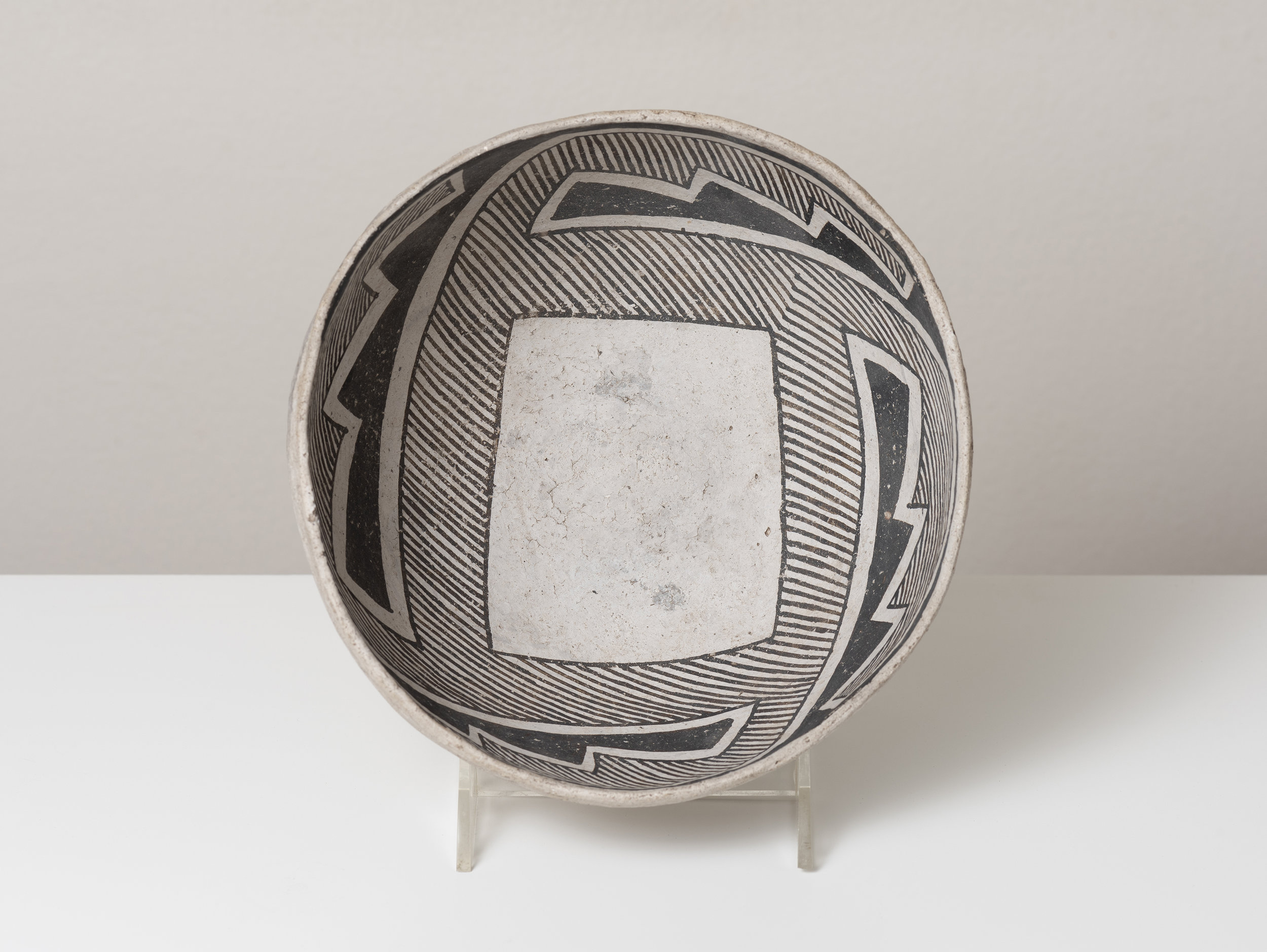 Socorro Black-on-white  Trance portal / directional abstraction c. 1100 - 1300 CE Painted ceramic 7 inches diameter, 4 inches depth