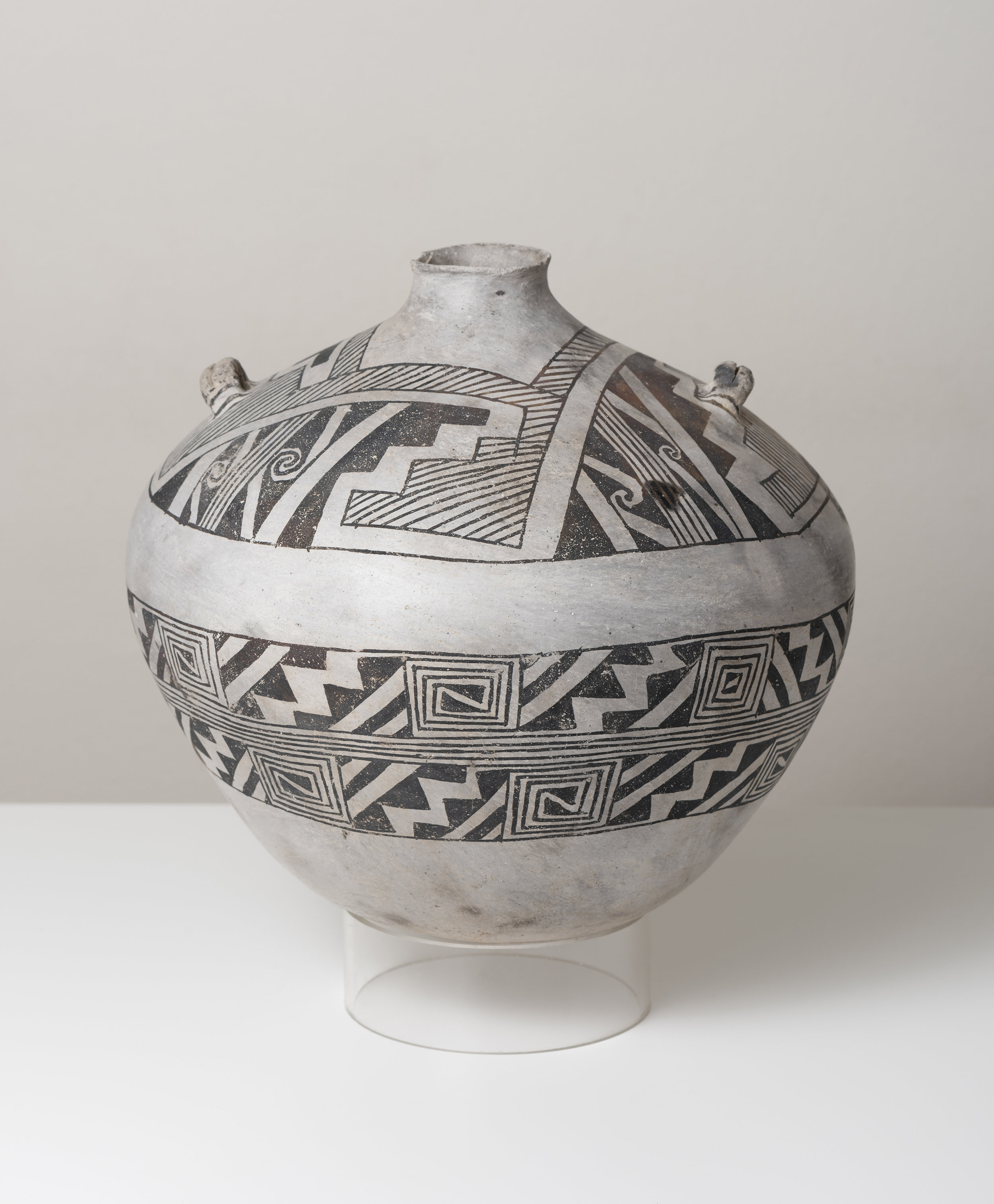 Socorro Black-on-white  Canteen c. 1100 - 1300 CE Painted ceramic 9 inches height, 10 inches diameter