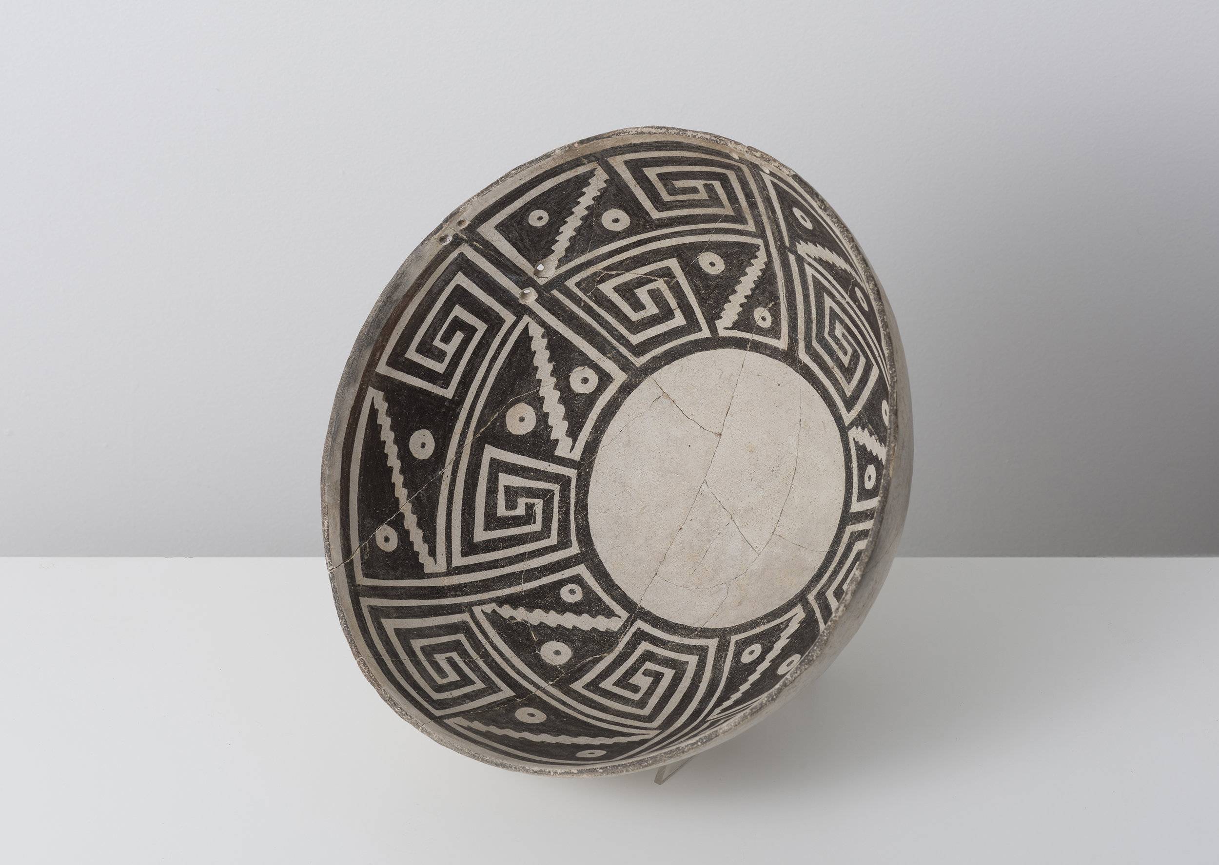 Classic Mimbres Black-on-white  Abstracted hawk moth proboscis / datura blossom c. 900 - 1000 CE Painted ceramic 12 inches diameter, 4 inches depth