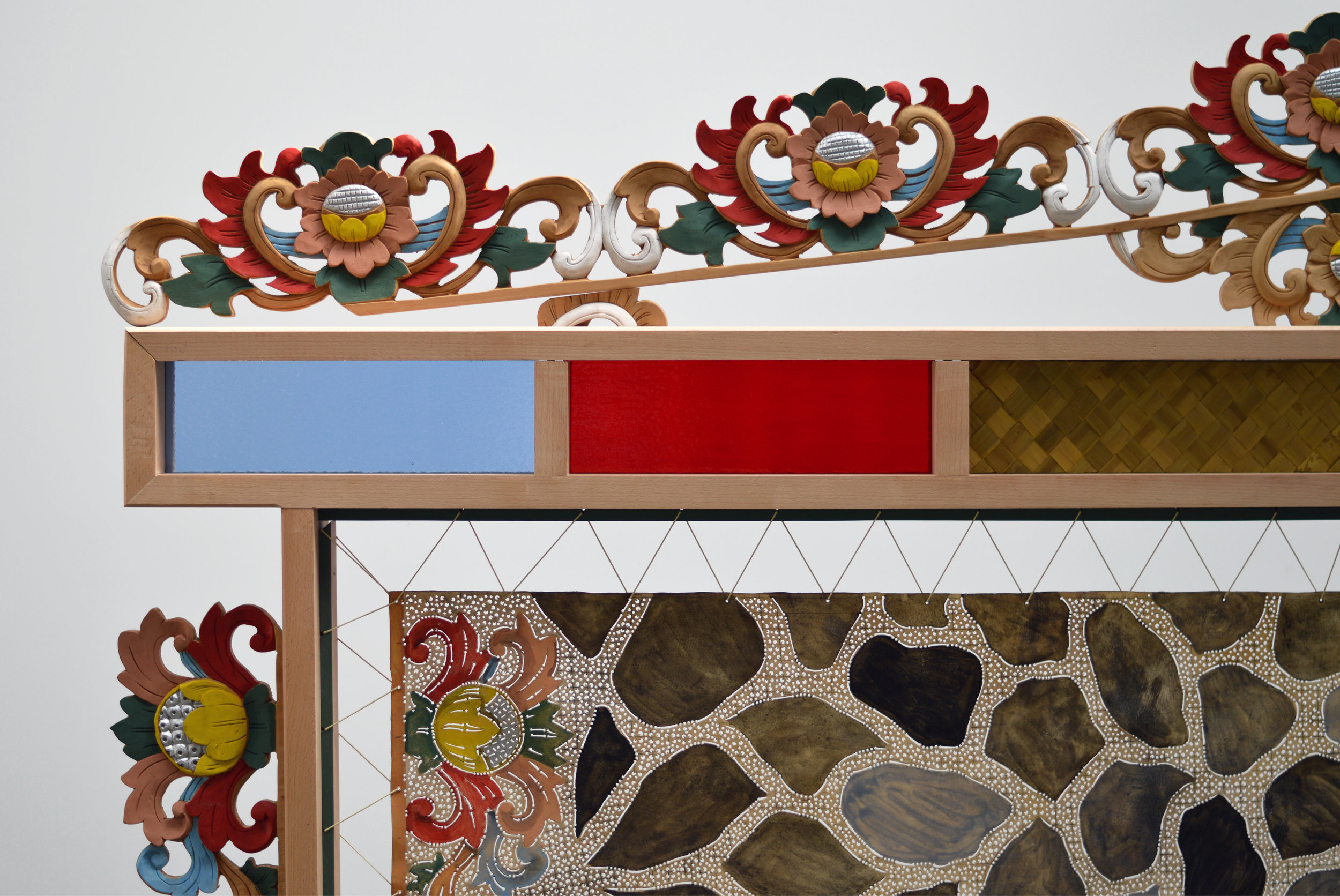 Adam de Boer   Room Screen for Mohawk Street  (detail)     2018 acrylic paint on hand carved hides, acrylic paint on hand carved teak, stained glass, and woven pandan leaf 74 x 96 x 16 inches