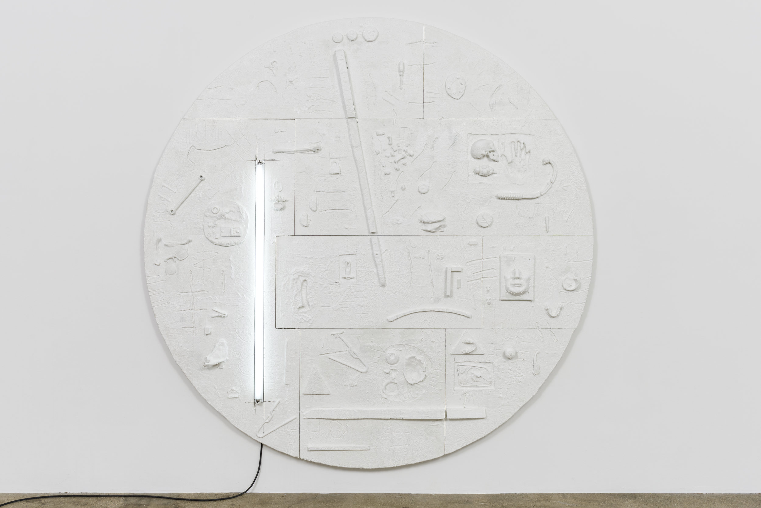 Don Edler  Two Minutes To Midnight   2017-2019 Plywood, styrofoam, plaster, miscellaneous detritus, fluorescent light, polymer paint, petroleum wax 92 in x 92 in x 3 in  Photo by Ruben Diaz