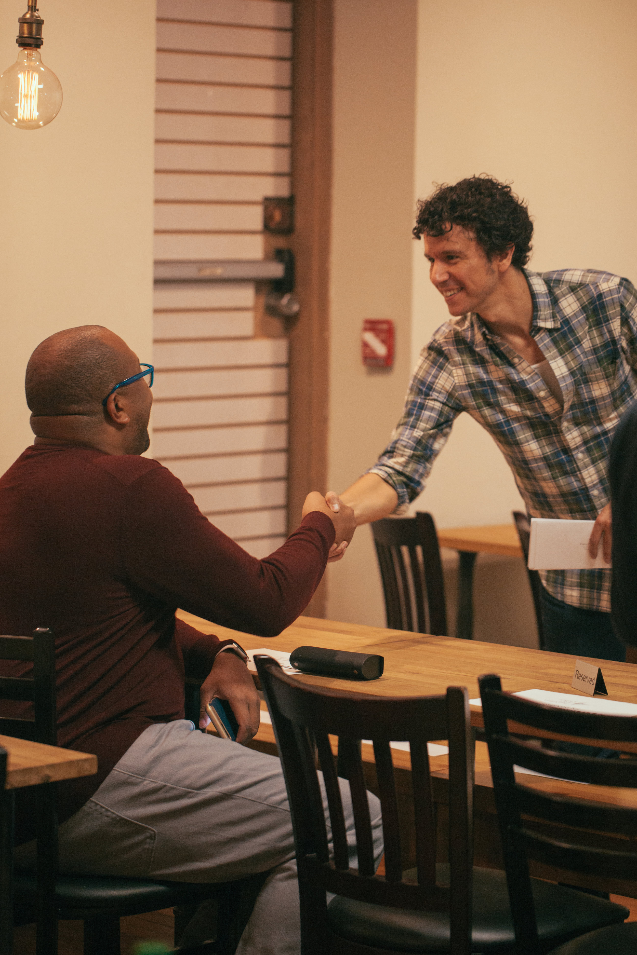 Co-Artistic Director Aaron Rossini greets an audience member.Photo by Katherine Oostman.