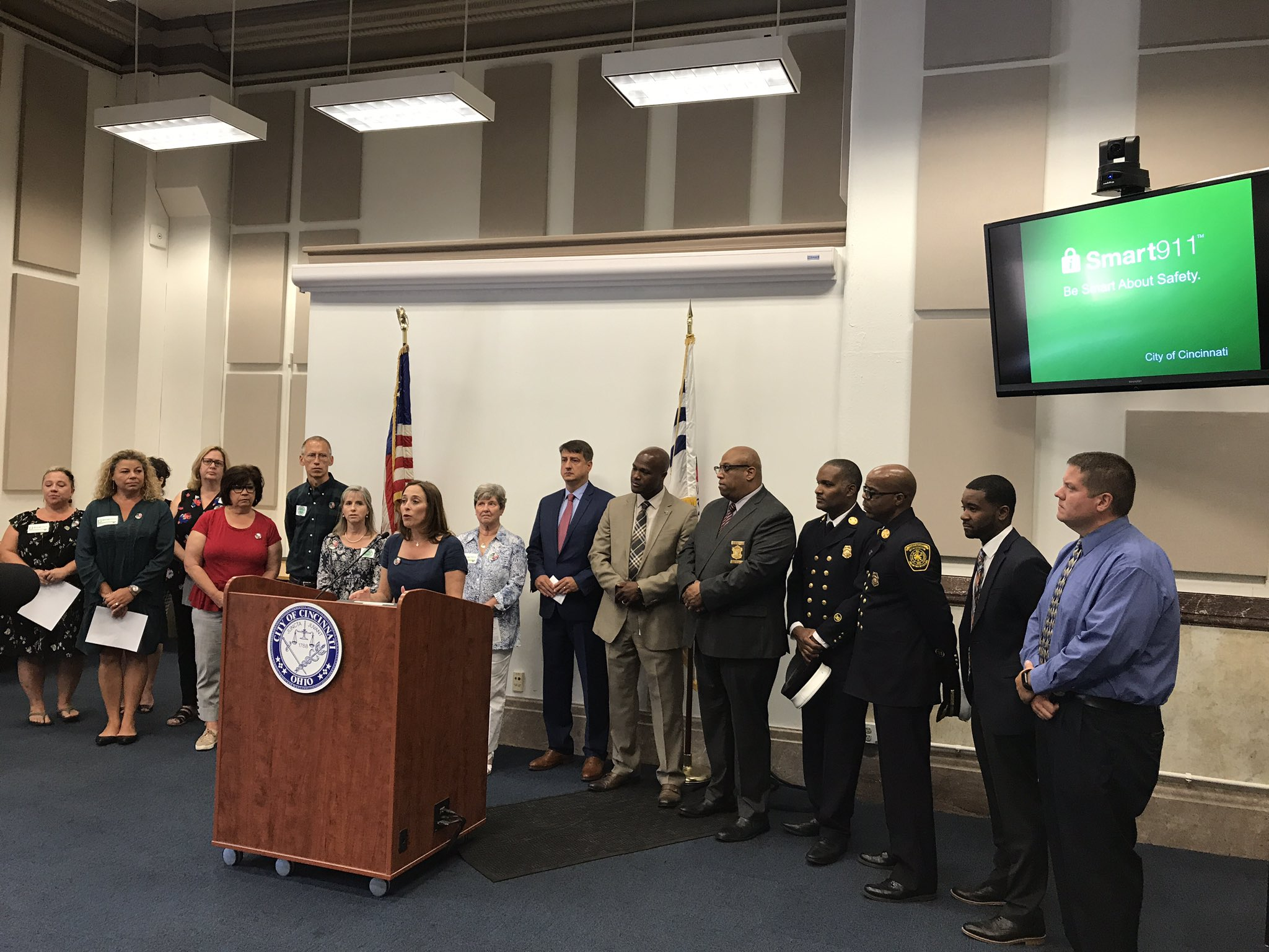Councilwoman Amy Murray invites residents of Cincinnati to sign up for a Smart911 safety profile. She is joined by members of the City Administration, public safety officials and the Plush family.