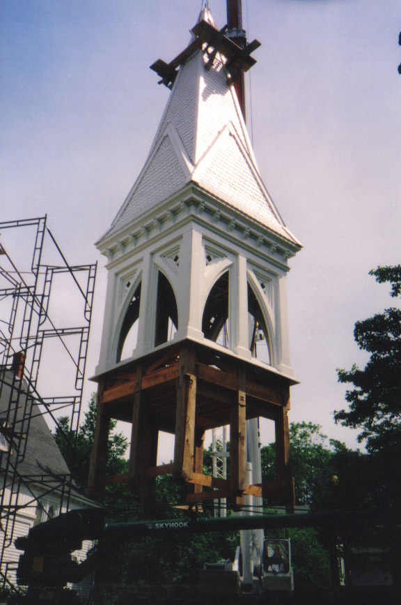 The reconstructed bell tower ready to be lifted back on to the church.