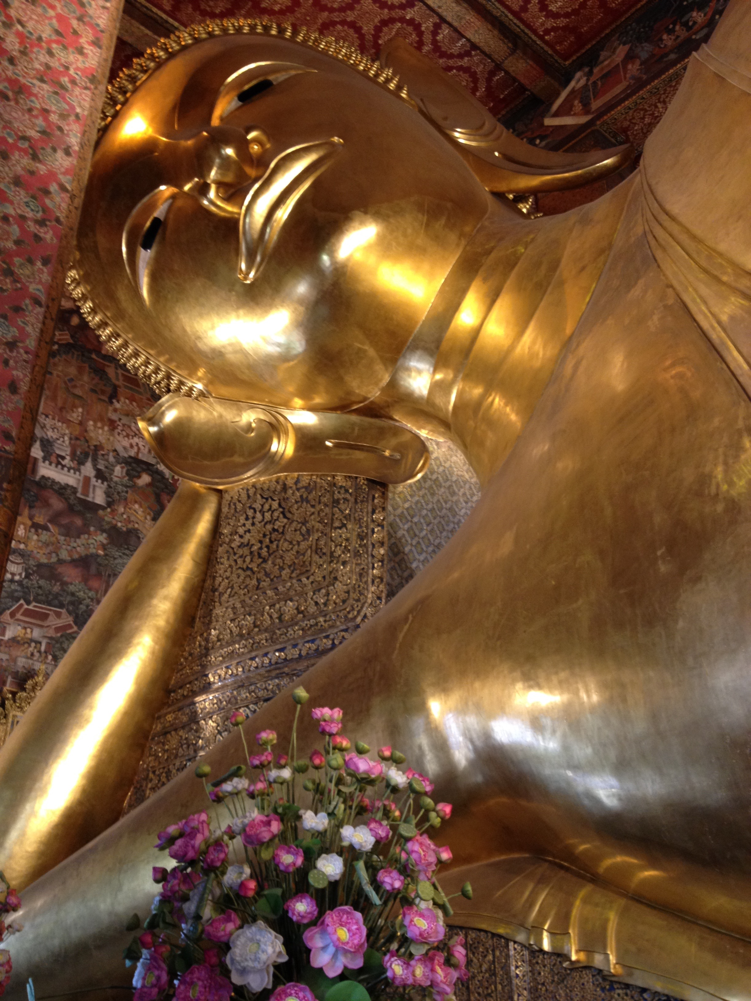 You've got your sitting Buddha, you're walking Buddha, your reclining Buddha, and your standing Buddha. This is from Wat Pho. Guess which one this is.