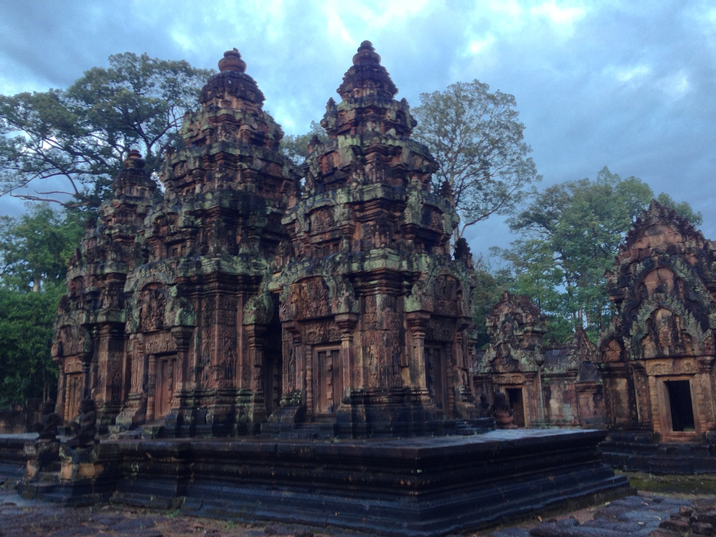 """Finally on to Siem Reap to visit Angkor Wat and the other surrounding temples. This is Banteay Srej, or the Citadel of Women, recognized as a tribute to the beauty of women. A big part of the """"wow factor"""" of these sites isn't so much the temples themselves as it is their surroundings and the mood they convey. This was shot just after a tropical downpour and the light captures some of that feeling. Sometimes you have to mentally photoshop out the other tourists in order to get the full effect, but it's not too hard to do this."""