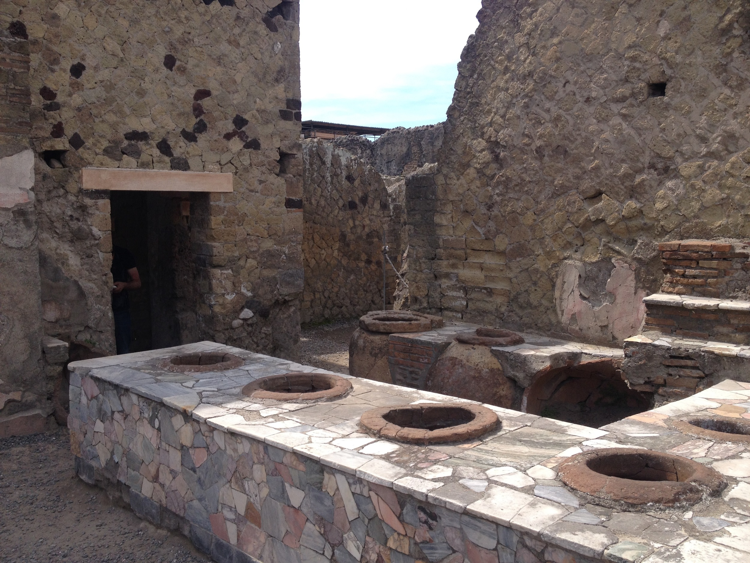We complain about the ubiquitous fast food stands, but even in the years BC, fast food places were everywhere. Above is one of many snack bars in Herculaneum, the various large urns built into the counters no doubt serving up the Big Macs and french fries of the day.