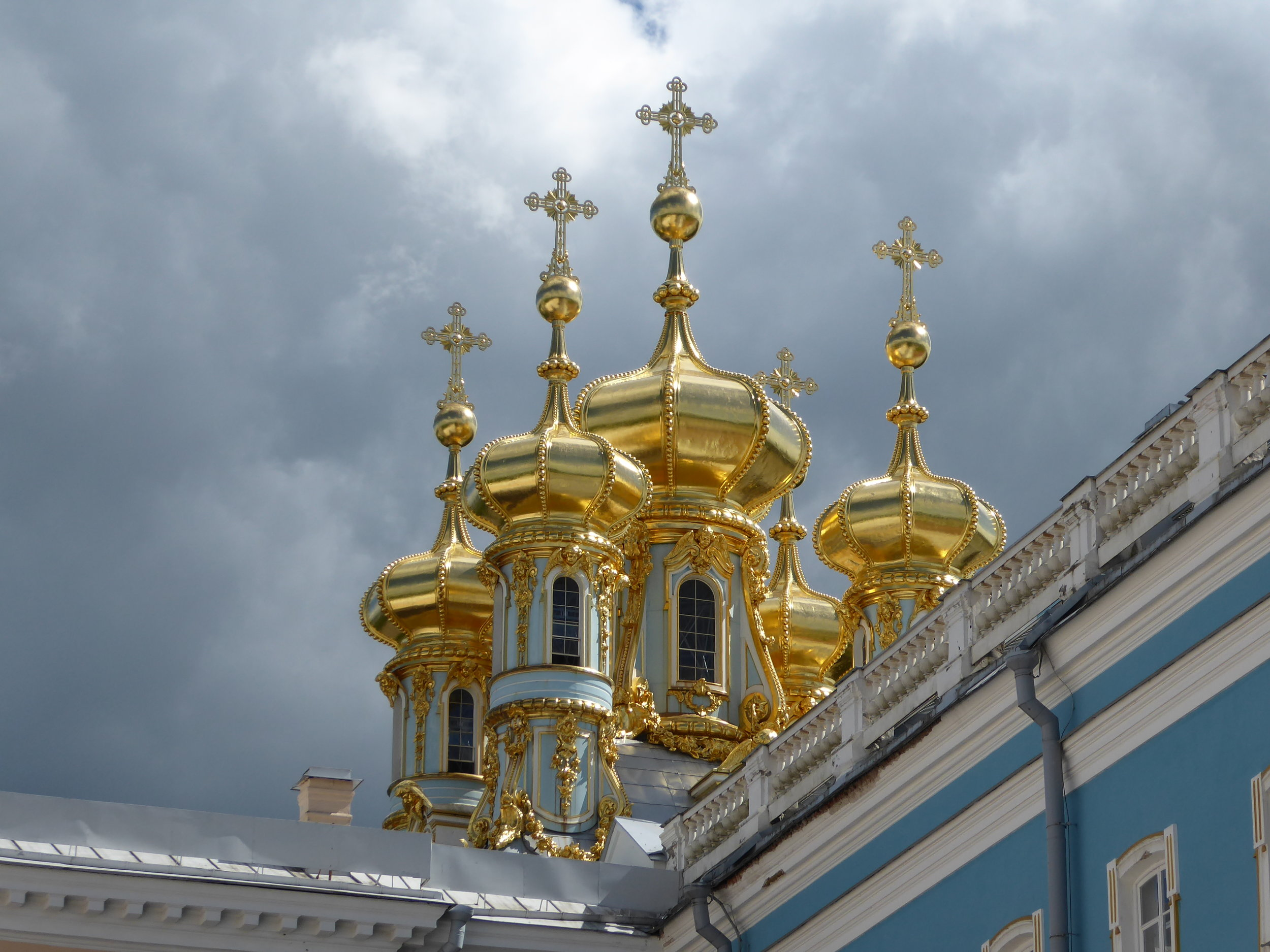 Catherine's Palace about a 1 hour drive from St. Petersburg in a pastoral countryside setting. Gold, gold, everywhere. Move over, Versailles...this place is incredible!