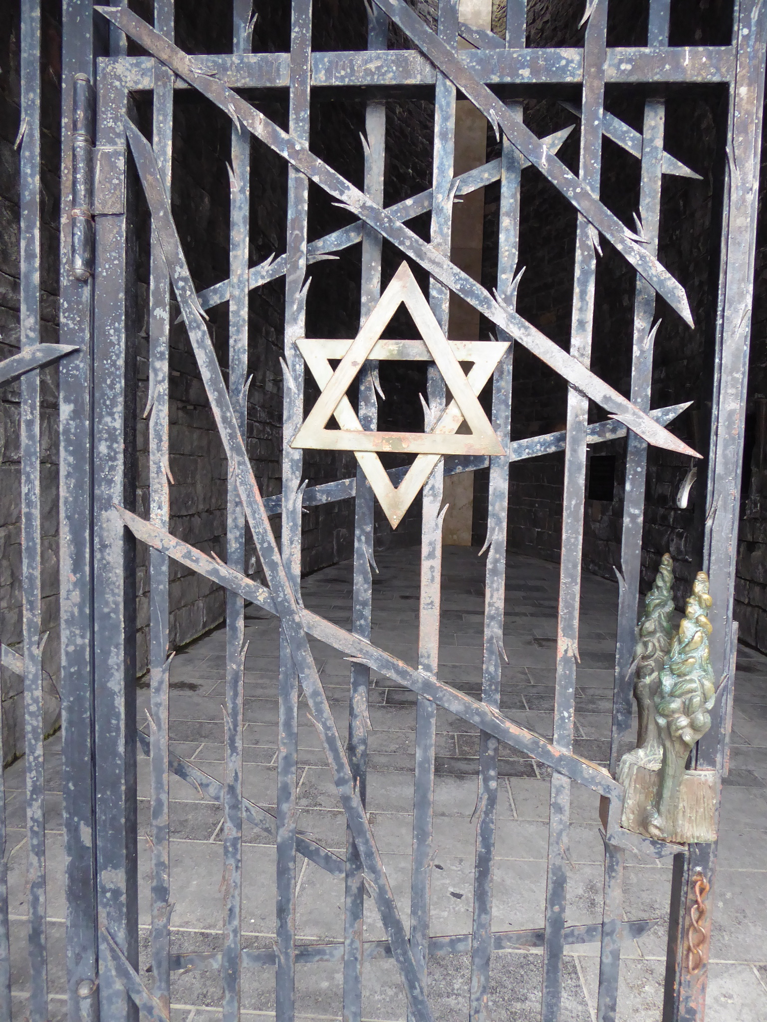 Gate of the Jewish memorial at Dachau.