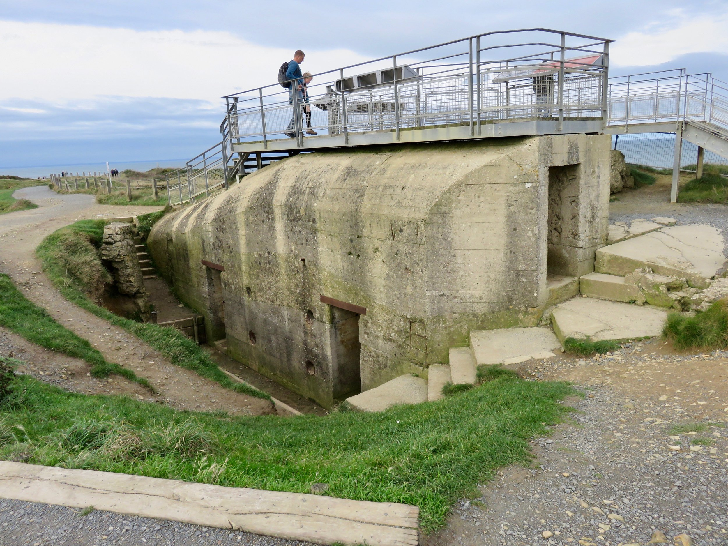 Remnants of German artillery bunkers are everywhere.