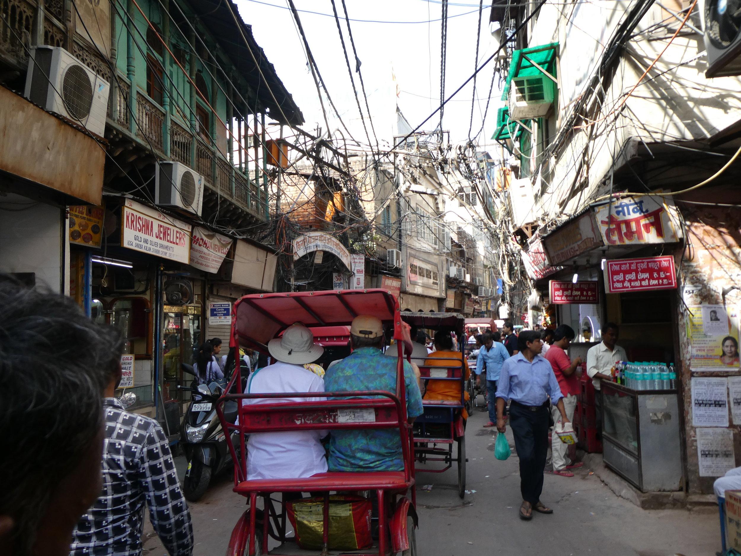 Bicycle rickshaw through Old Delhi.