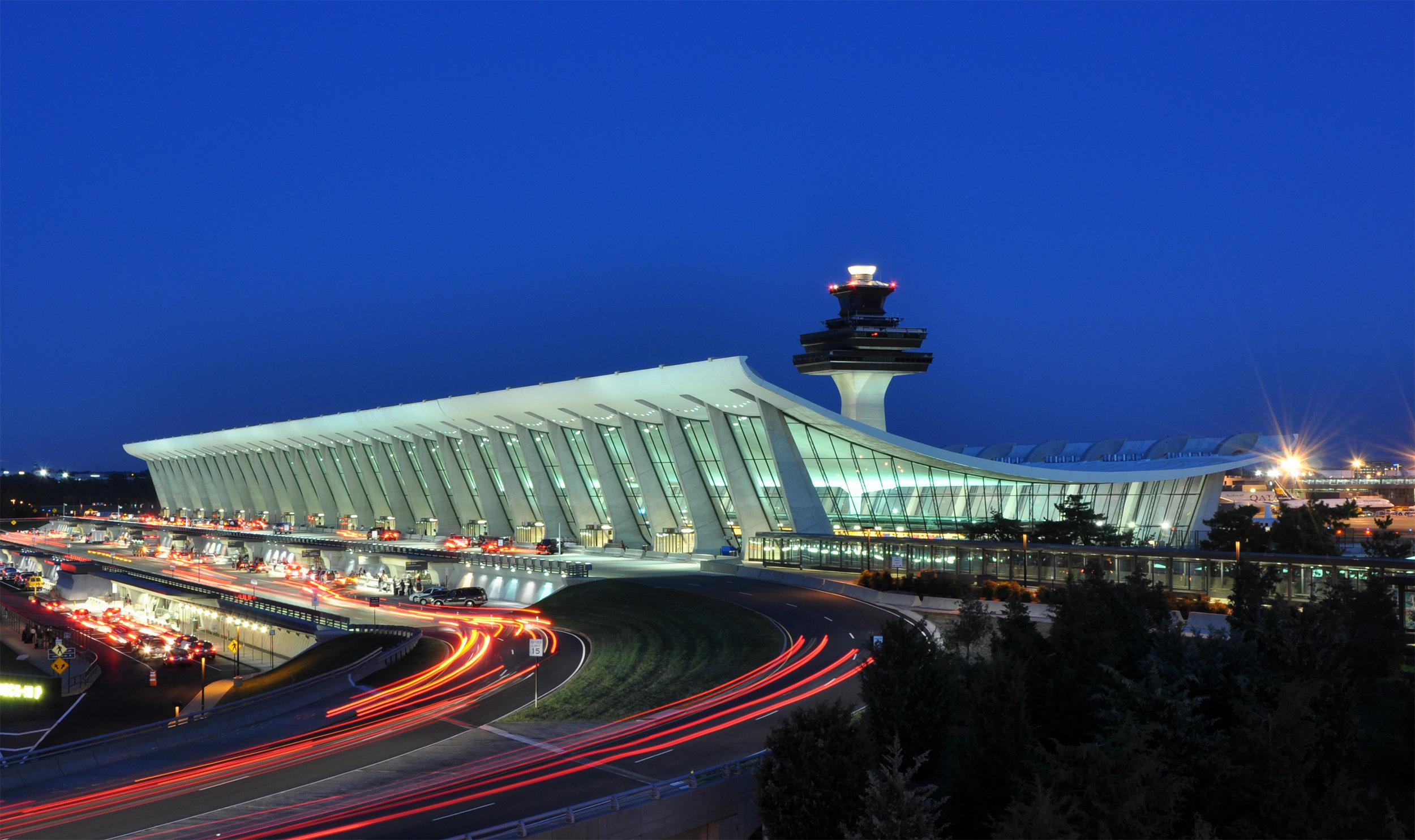 Dulles terminal building at dusk. ( Photo by By Joe Ravi , via Wikimedia Commons,CC BY-SA 3.0)