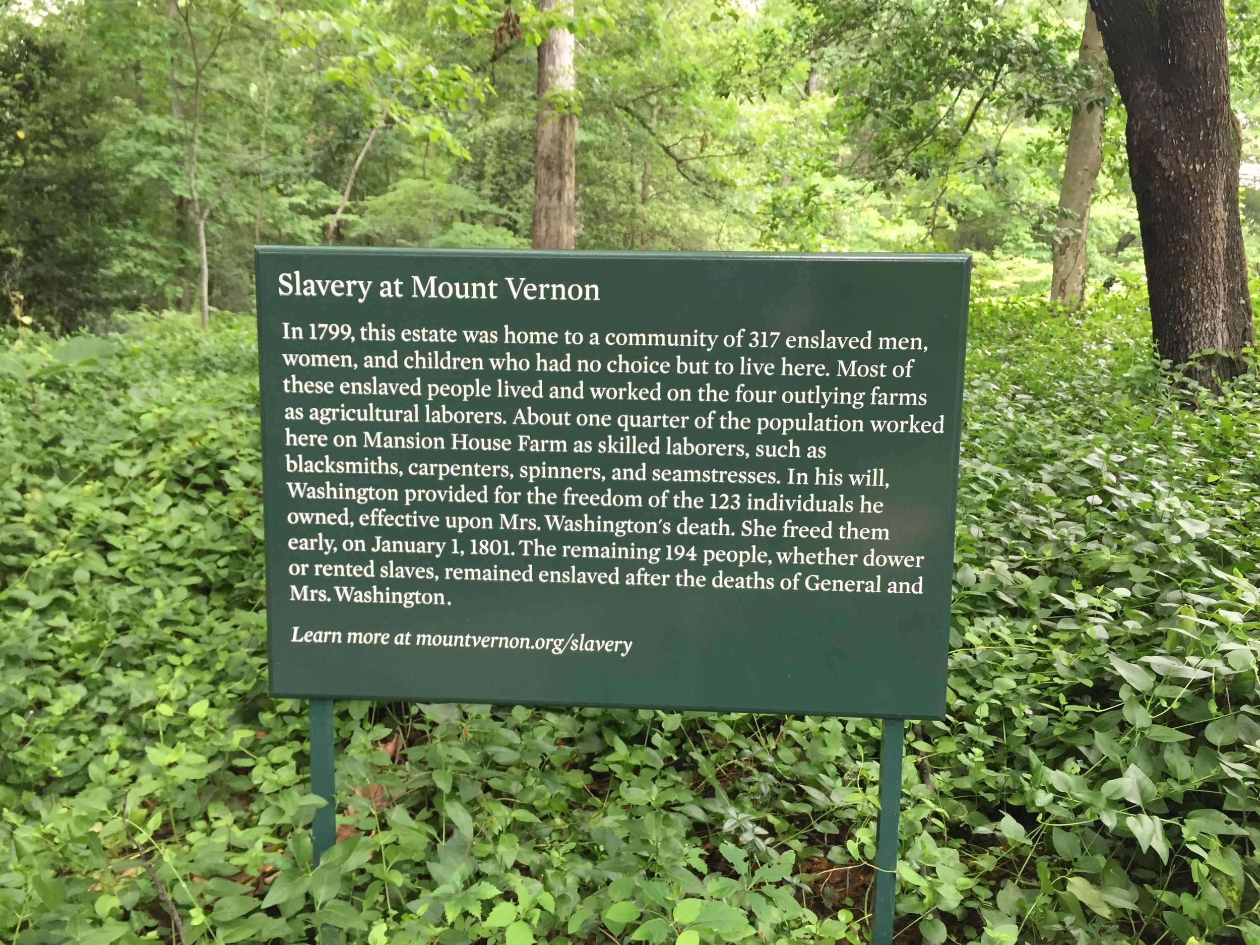 A sign near the Slave Memorial explains the details of Slavery at Mount Vernon.