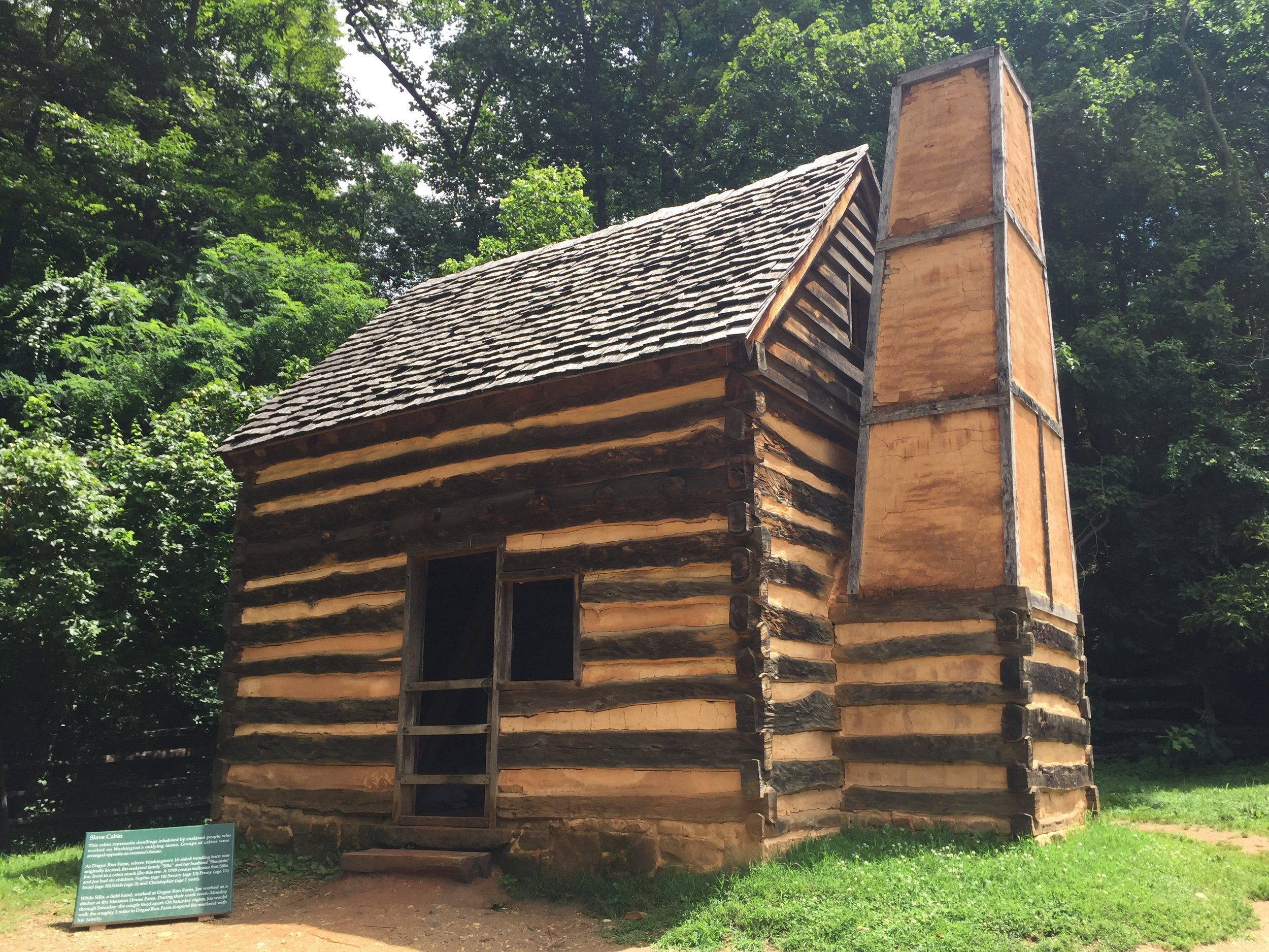 A reconstructed slave cabin at Mount Vernon. The sign near the cabin describes how a family of eight lived in a cabin like this one.