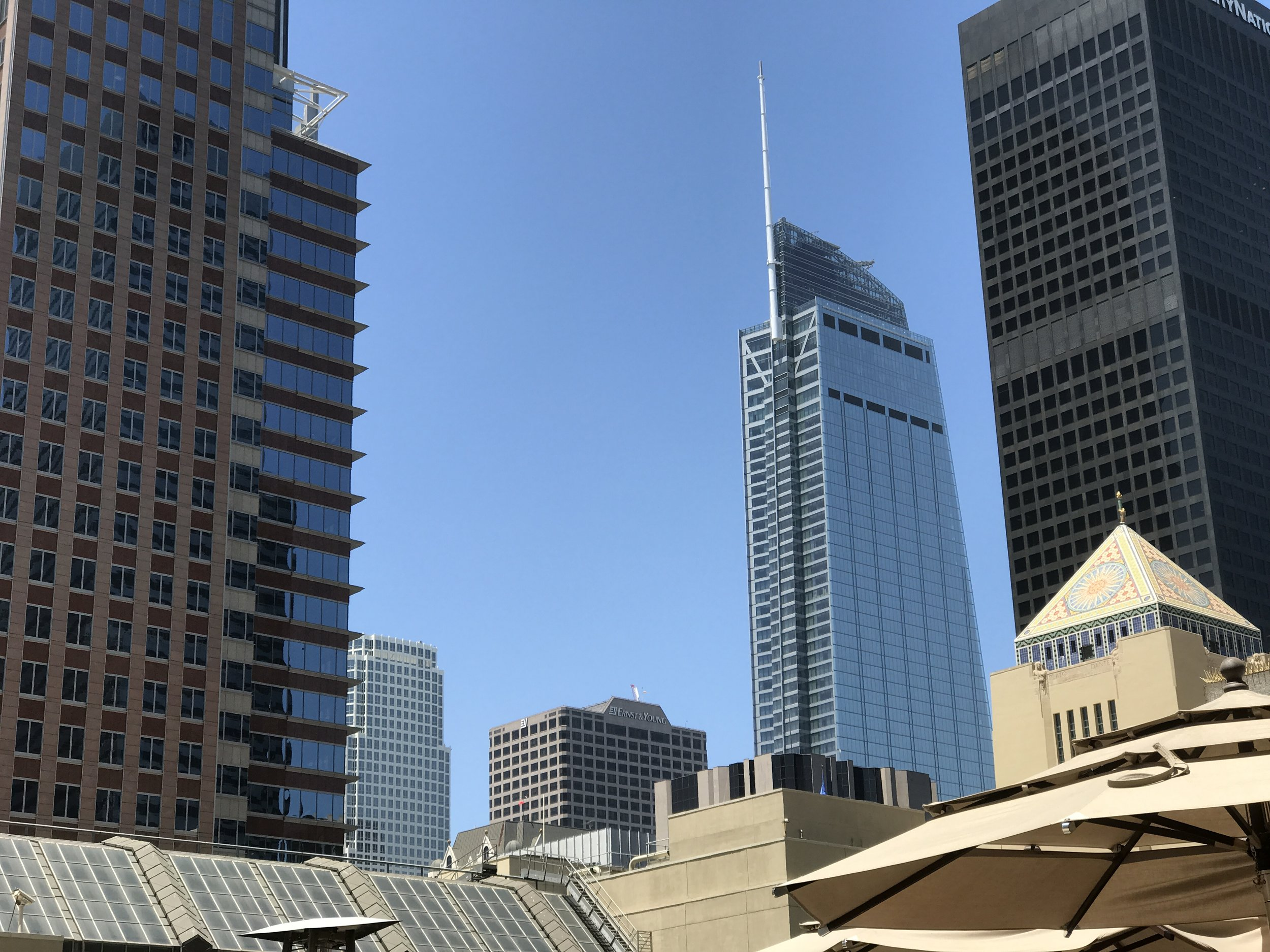 Wilshire Grand Center rising above the Los Angeles Central Library.